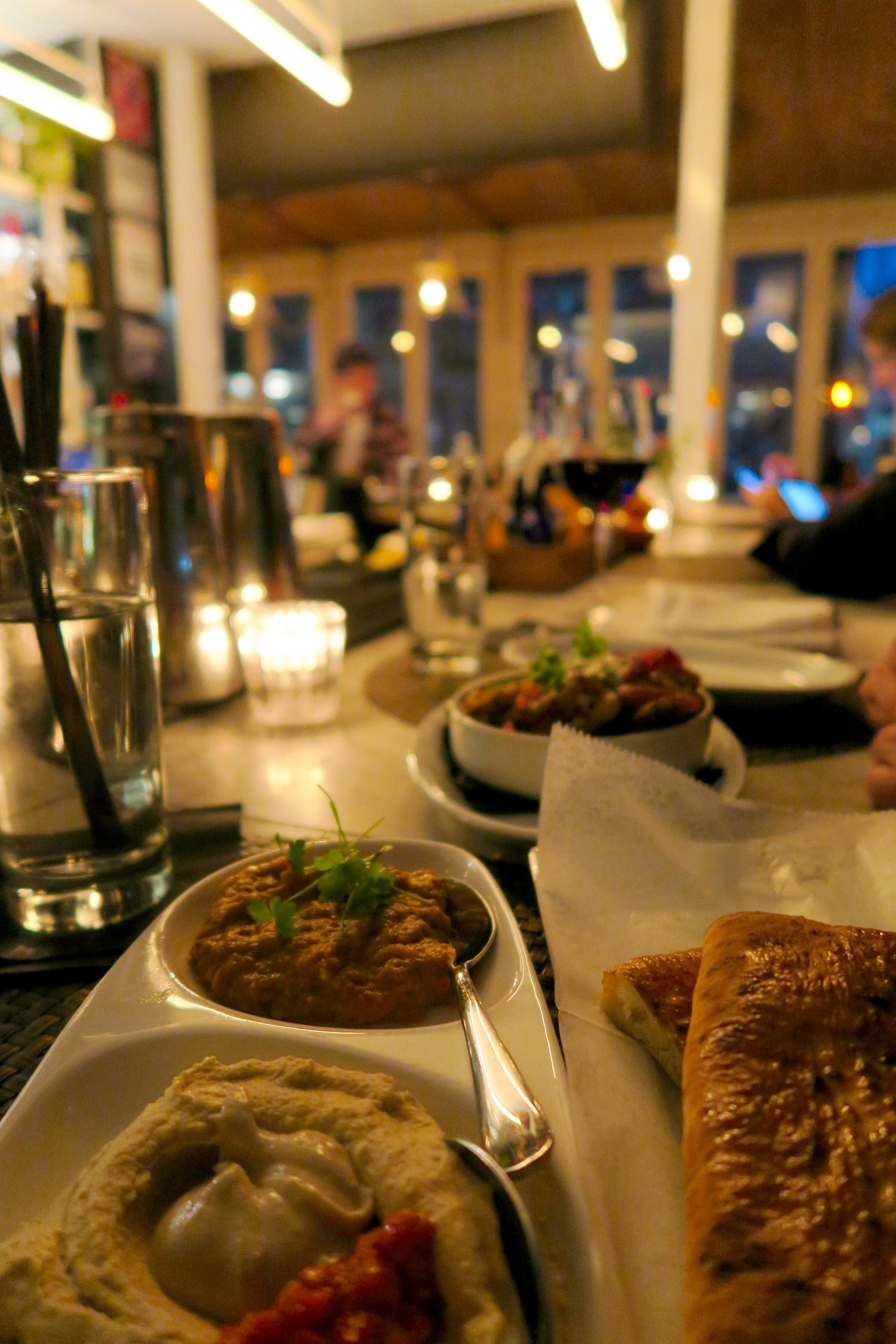 Three Good Things  Hummus, labnneh, red baba, pita