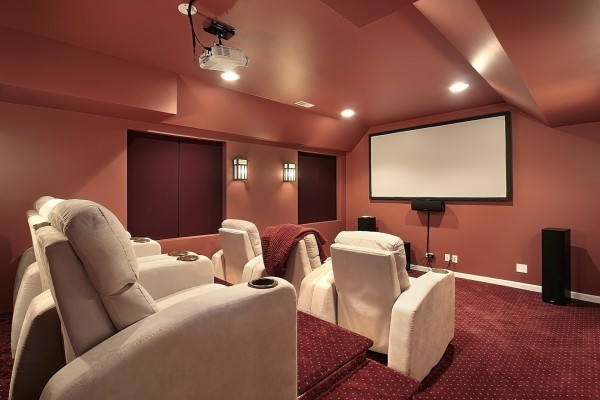 photo-of-home-theater-with-red-painted-walls-and-white-leather-recliners-Custom-600x400.jpg