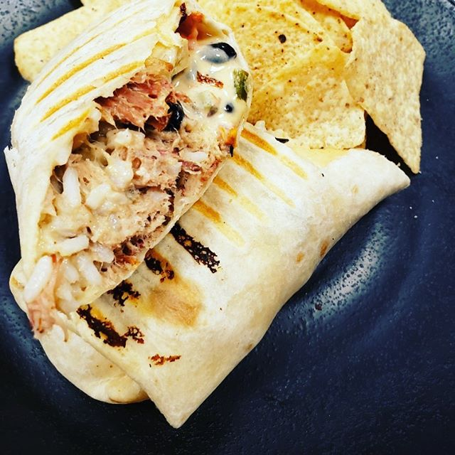 Today's special is a grilled pork burrito with rice, beans, and house queso. Served with tortilla chips. $8. You can get it for lunch or dinner or late night!