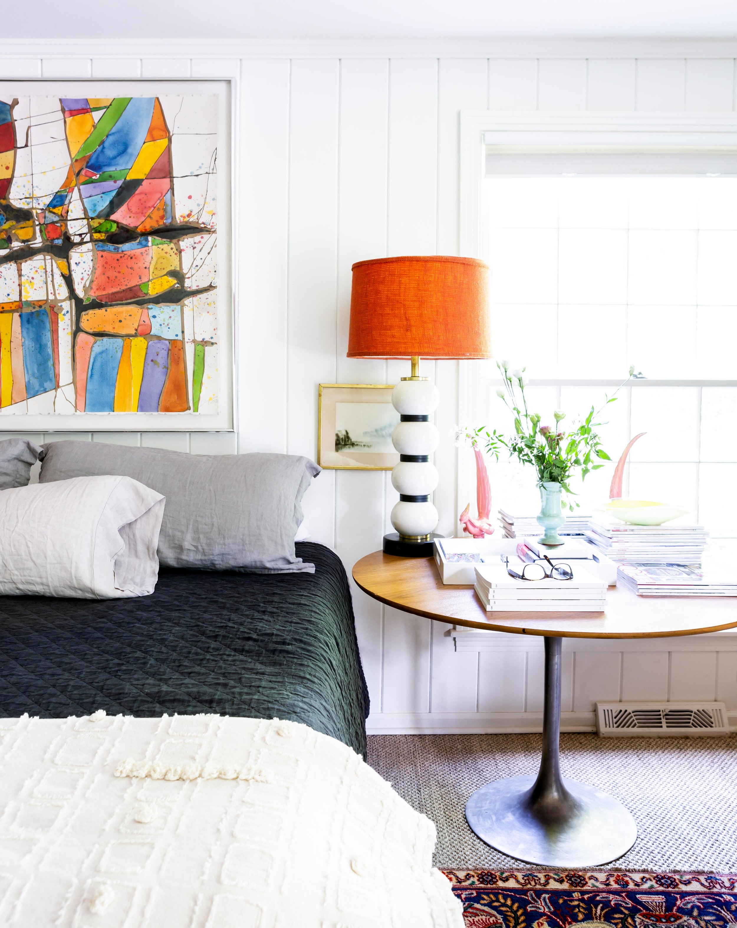 """My favorite piece of art is in our bedroom, hanging over our bed,"" Colleen says of a splashy, boldly colored abstract painting by the late Marianist monk and artist Brother Mel Meyer. ""I would not say we're collectors of art. But when we moved to Nashville, we bought that piece. It was our first real piece of art."""