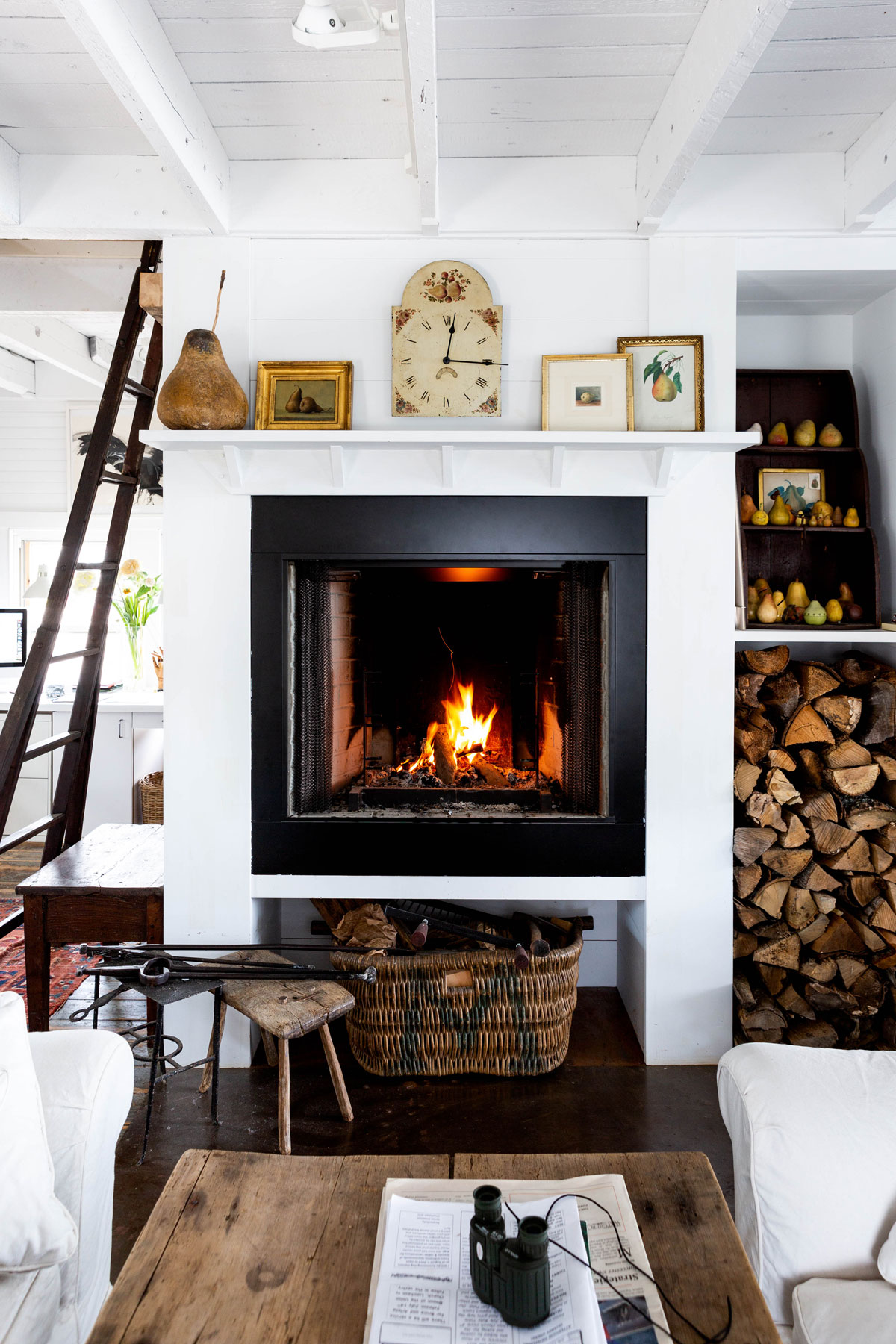 A good fireplace and a hefty woodpile are household requirements in Maine, even on midsummer nights. That's why Paul planned for a built-in firewood niche. Fuel for the fire is always within reach.