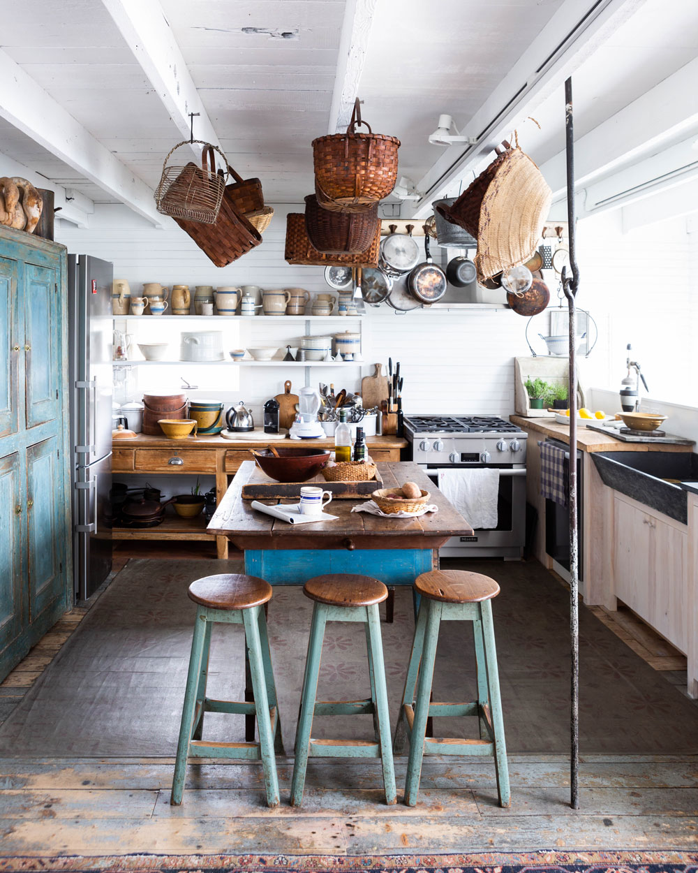 The Mrozinskis cook every meal together, and it shows. Well-used pots and pans. Knife marks in the butcher's block. A prep-slash-dining table. This is clearly a working kitchen, even with its whimsical basket and pottery displays.