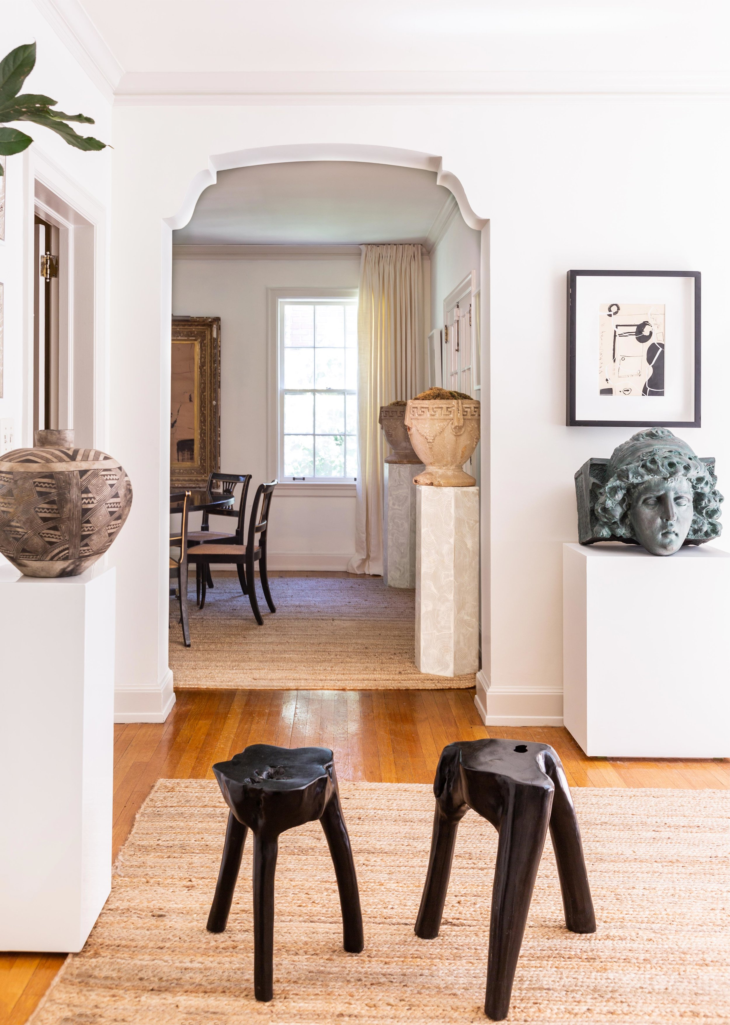 A Columbian vase, a terra-cotta bust painted by McLure's assistant to look like copper, and black wooden stools from Design Supply, in Birmingham, Alabama.