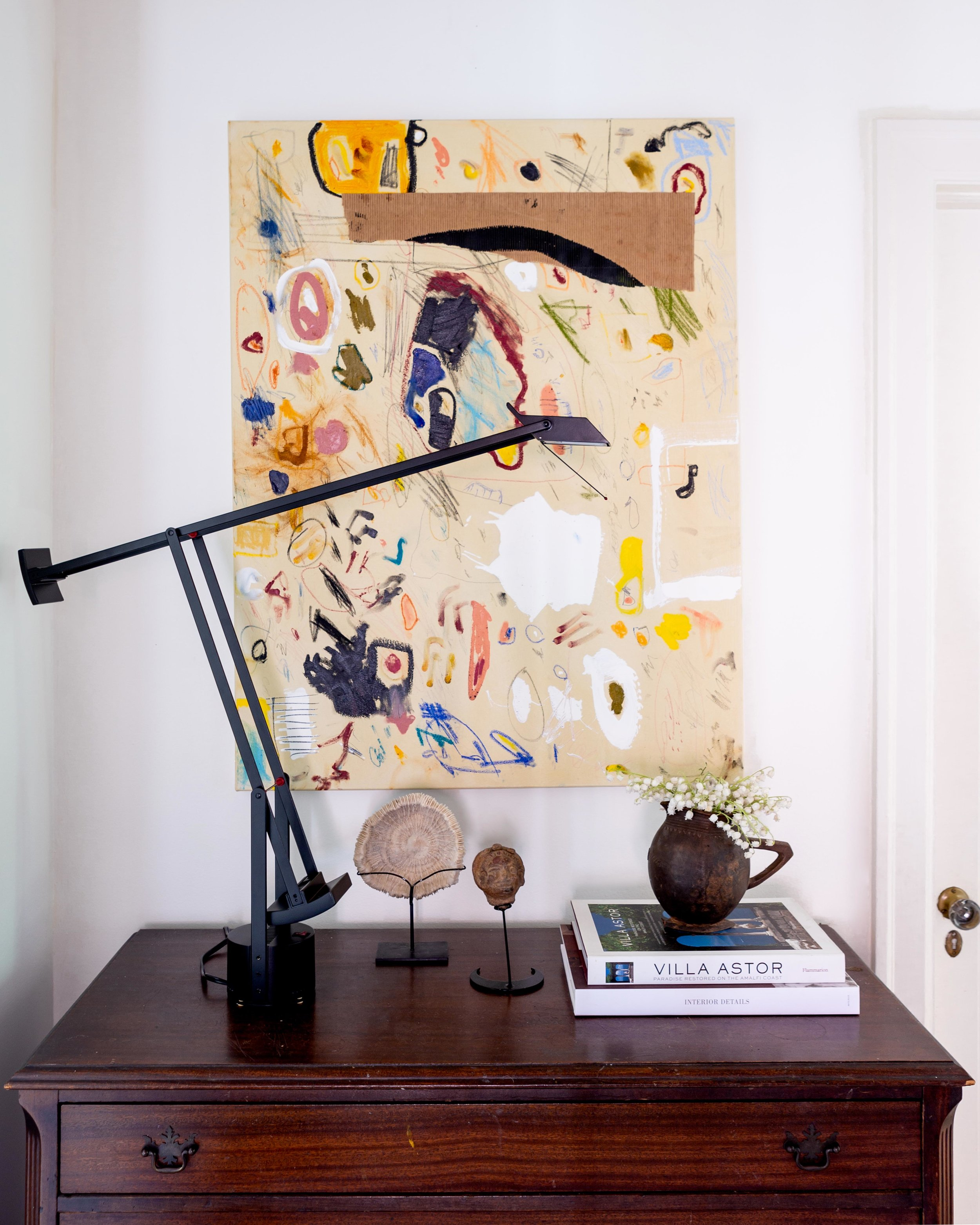 One of McLure's abstract canvases is hung above an antique chest that he's had since he was 13. The sculptures were Christmas gifts from Mama McLure.