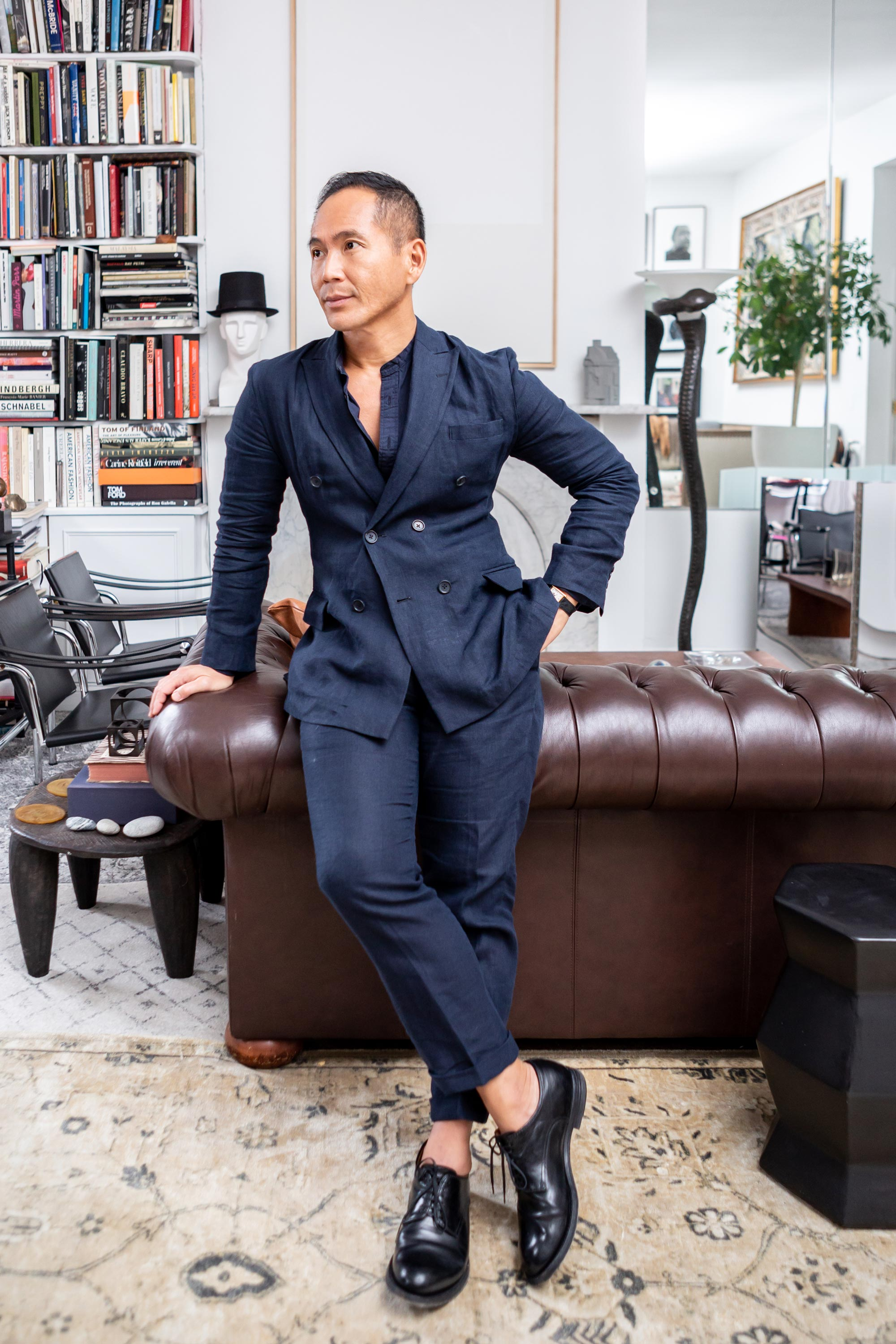 Marcus Teo in his little museum of an apartment.