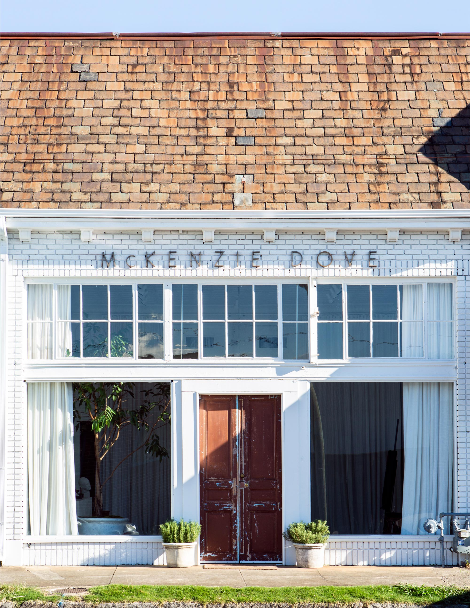 """Dove had custom drapes made by her friend, Grant Trick, for the studio's enormous floor-to-ceiling front windows. """"They're the perfect fabric because the light filters through them, so I always have the right light for painting,"""" she says."""