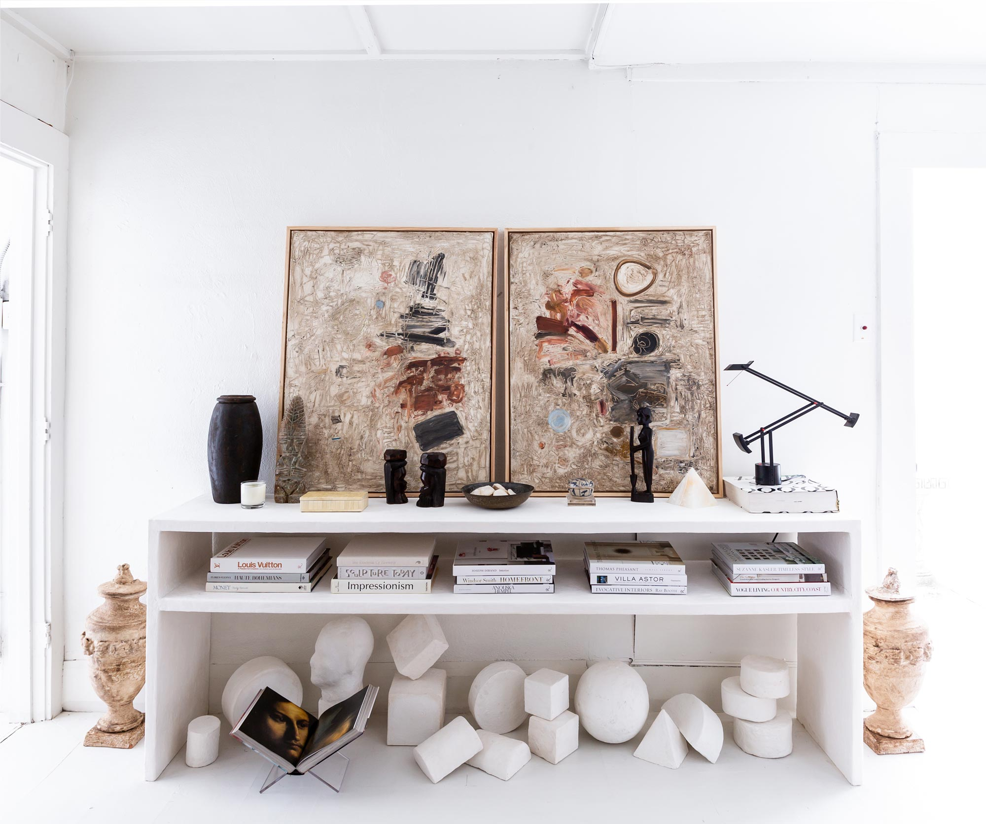 """Since moving into the studio, Dove has finally been able to regularly explore plaster as a medium for her artwork. She has made tables, small-scale geometric sculptures, and semi-figurative busts—even wall-mounted pieces that use plaster shards as their primary material. """"I've always played with plaster, but it's so dusty and messy that you can't really do it in your house,"""" she says. """"You have to really commit to the dust mask and everything."""""""