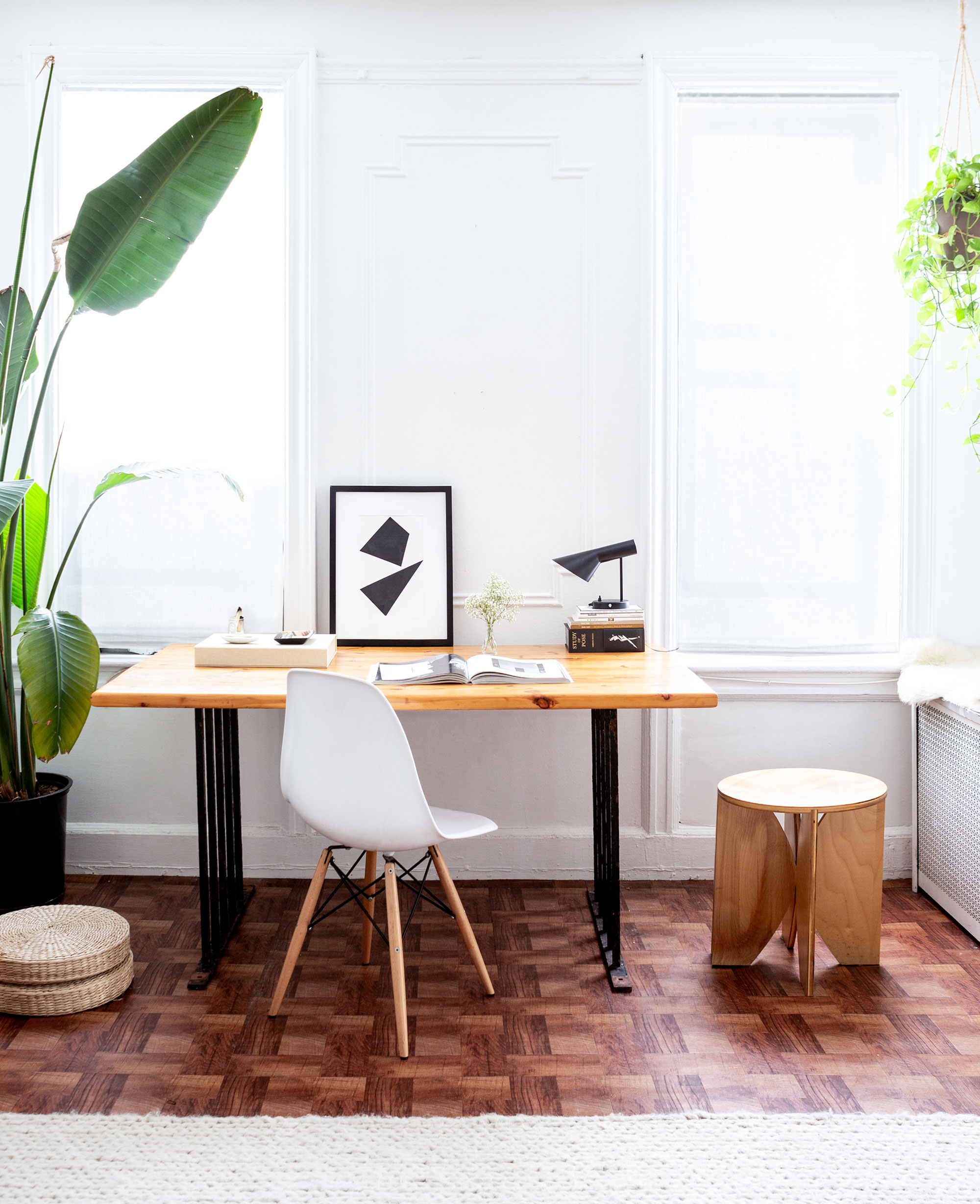 """""""We had Dermot's dad, who's a retired master carpenter, build us a dining table that doubles as a worktable, and the bench and stools that go around it,"""" De Smet mentions, gesturing toward the custom furniture that fills the studio. """"I especially love the bench because it's super versatile; I use it for seating, for props, for anything you can think of. It was important for me to have pieces that are minimal, functional, multipurpose, and beautiful. Kind of like the clothing I make."""""""