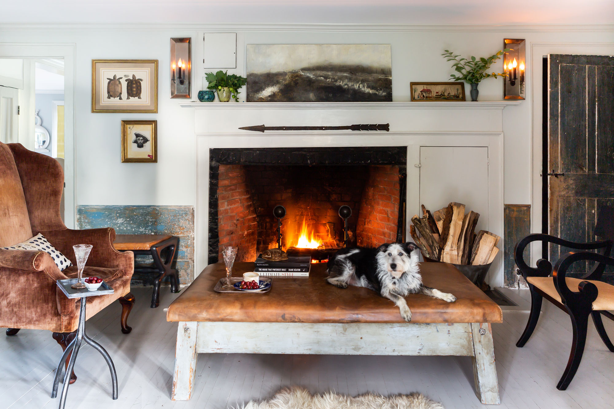 """The Randalls are a family of six: Natalie, Greg, their three kids, and Willa. """"The interior designer Bunny Williams, she's a friend of ours, and she has all of these scruffy little rescue dogs, and I said to her one day, 'Oh, I love all of your dogs,' and she said, 'I'm going to find you a dog,'"""" Natalie says. """"She actually sent me some tear sheets of scruffy little dogs, and that's how we found Willa. She came up on a bus from Georgia. She's our mascot. She comes to work with us every day."""""""