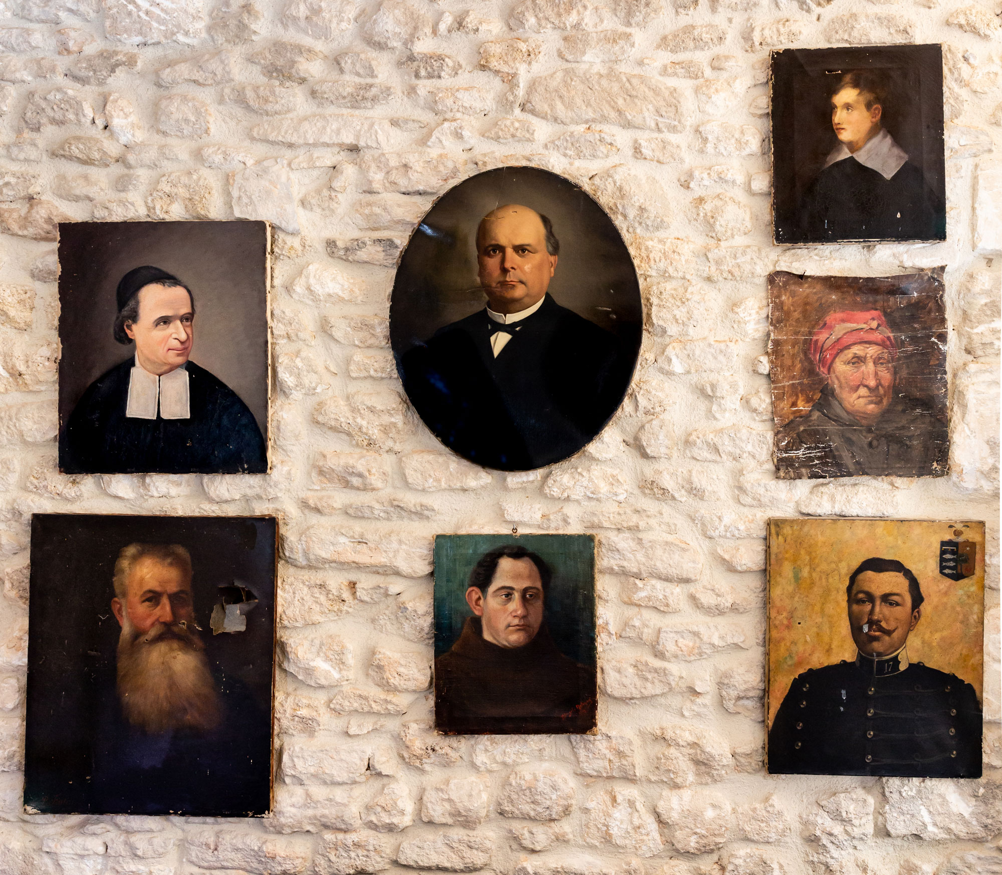 "The Mrozinskis' collection of classical portraits, many found in the markets of Provence, hang from the stone walls of their library. The room is reminiscent of the 1,000-year-old subterranean homes built on this hill. ""We have, beneath our building, 'des caves,'"" Paul explains, using the French pronunciation, ""kahhv."" ""They are dug into the ground, and they use the classic vaulted ceilings with stone. You can see, just from being inside them and the way that they are connected, that people lived in them."""