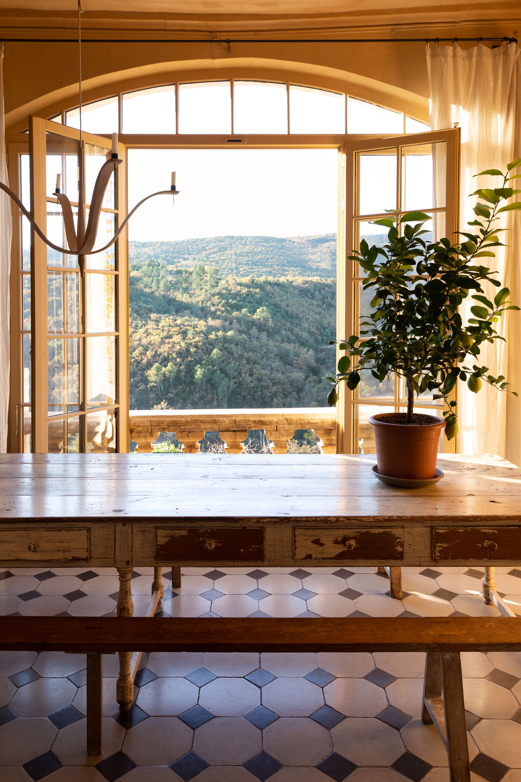 Looking out on the forests of the Luberon, Sharon and Paul's Bonnieux apartment is one of several created centuries ago by splitting up a regal country home. Many were constructed during the 14th century, when Pope Clement V, a Frenchman, moved the Catholic Church's headquarters from Rome to Avignon for 67 years.