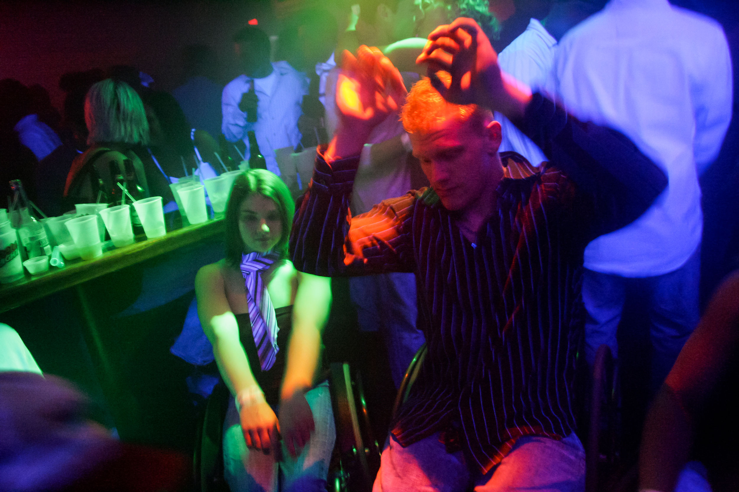Matt Buchi dances with women's track athlete Jessica Galli at Joe's Brewery in Champaign, Ill., for a night out to celebrate his 21st birthday. Despite the difficulty of getting into crowded bars, they still go.