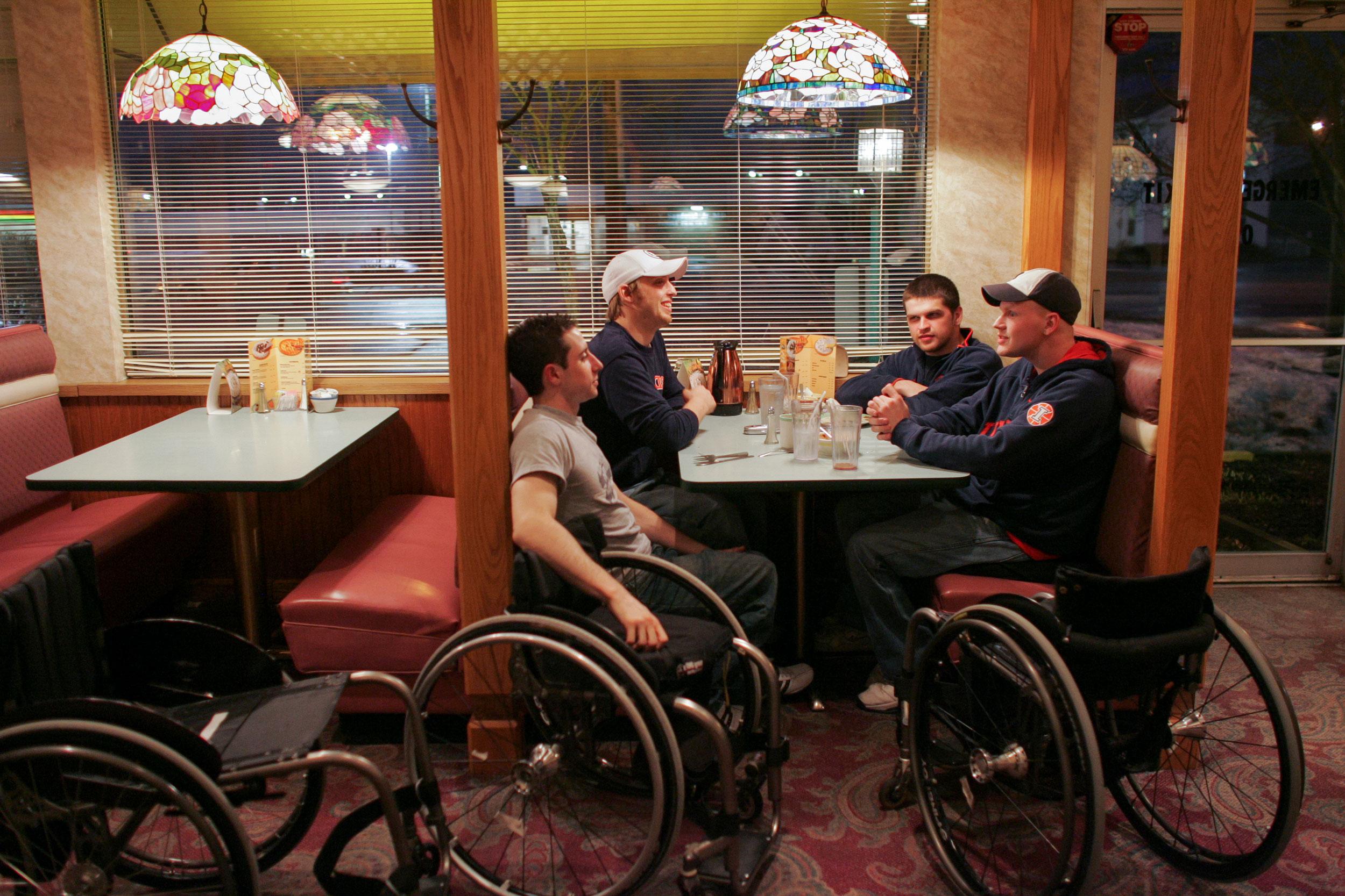From left, Steve Serio, Brandon Wagner, Brian Sheehan, and Matt Buchi eat dinner together at Perkins Family Restaurant after an Edinboro University tournament.