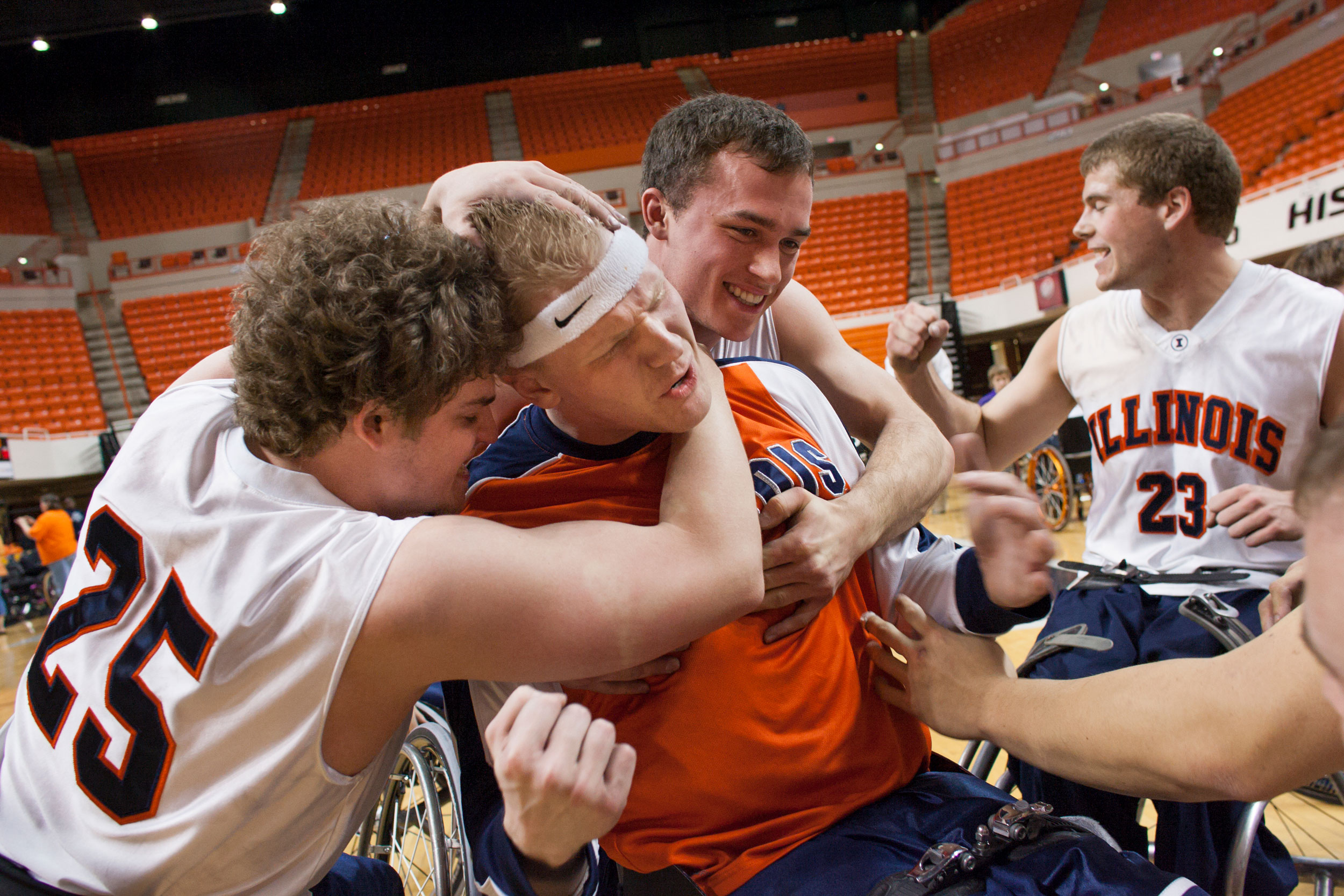 From left, Joey Gugliotta, Matt Buchi, Tom Smurr, and Lars Spenger celebrate after Illinois defeated Wisconsin-Whitewater, 63-58, to win the 2008 National Intercollegiate Wheelchair Basketball Tournament championship.