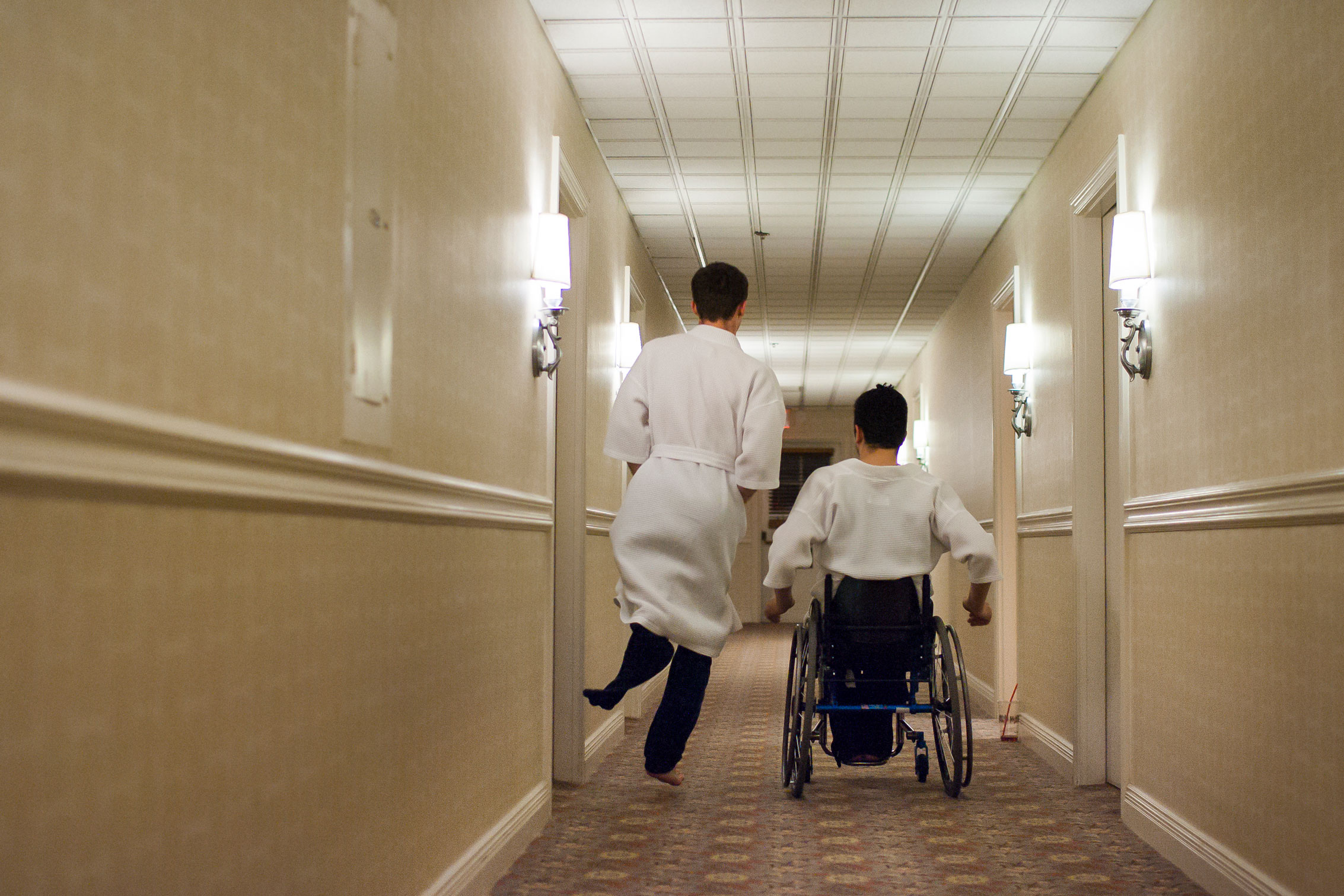 Tom Smurr and Jaime Balthazar proceed down the hallway of their hotel later that night.