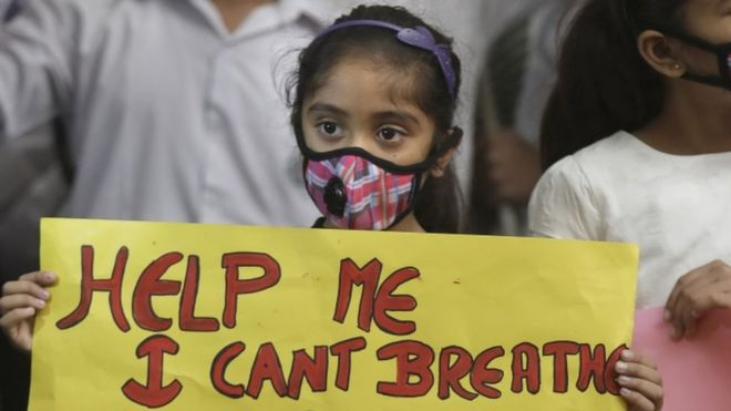 An-Indian-girl-holds-a-banner-during-a-protest-against-air-pollution-in-Delhi.jpg