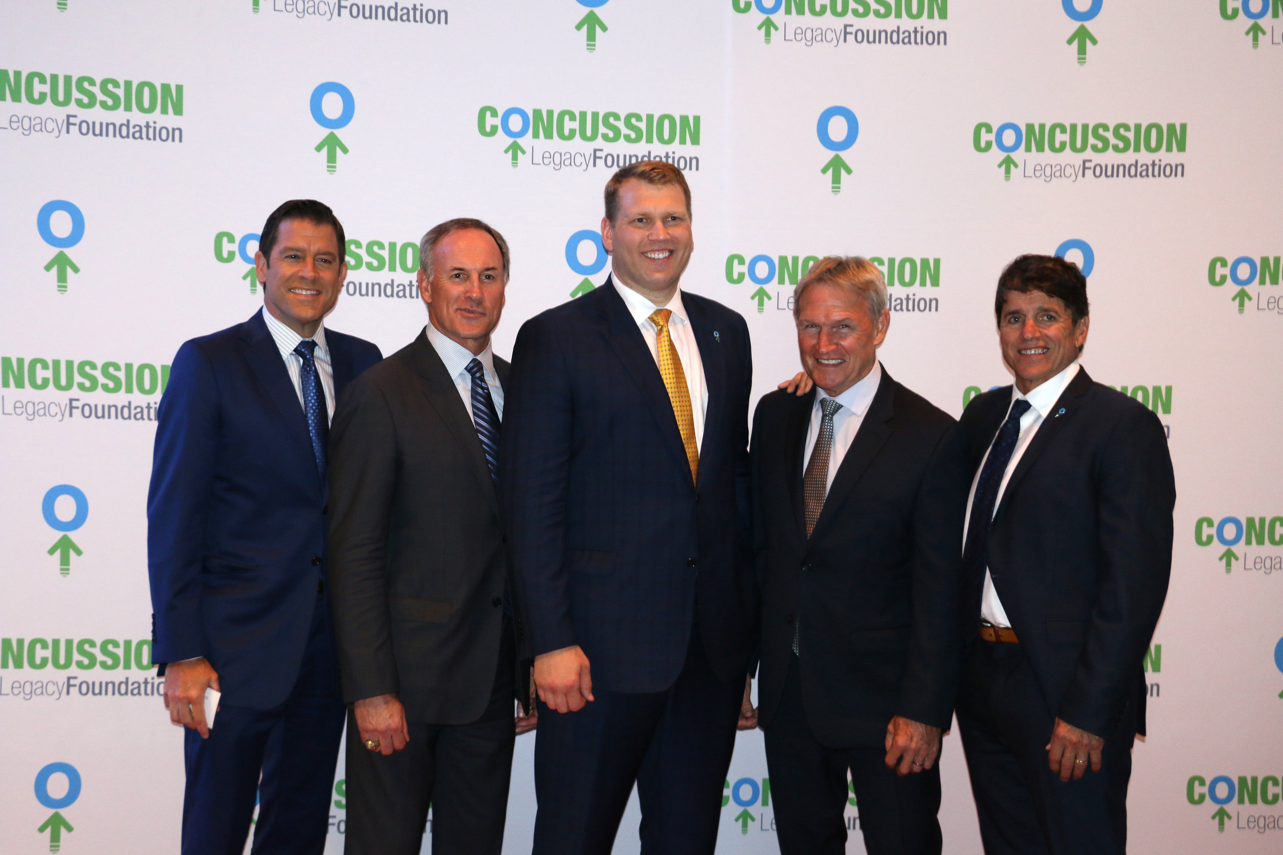 Chris Nowinski, center, poses with CBS Chicago news anchor Rob Johnson (from left), former Chicago Bears safety Gary Fencik, former Bears safety Doug Plank and former Bears running back and WWE personality Mike Adamle at the Concussion Legacy Foundation's Chicago Honors on June 28, 2018. (Photo by Mike Pankow)