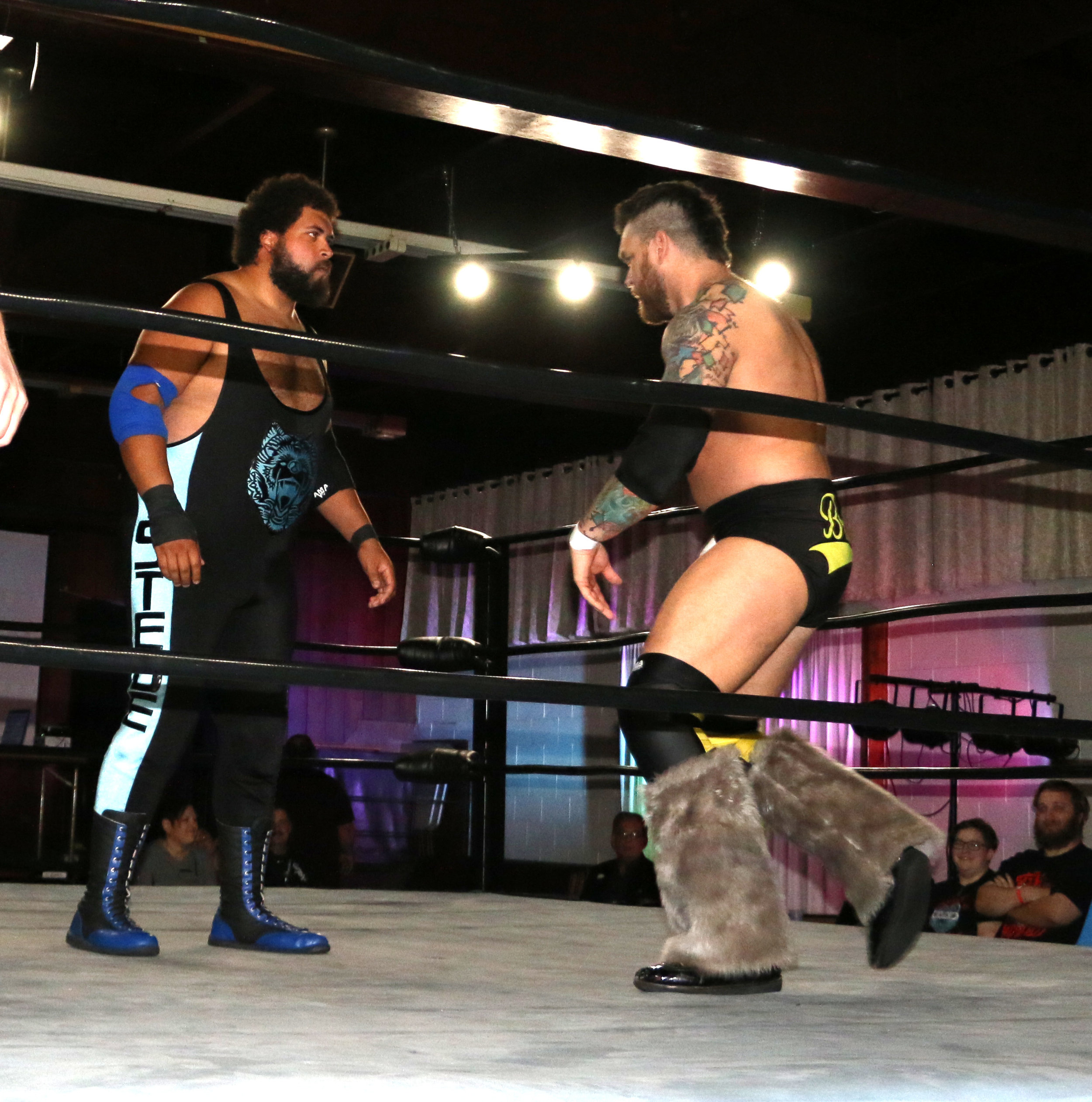 Steve Michaels, left, sizes up veteran Jay Bradley in their semi-main event match of Berwyn Championship Wrestling's show at the Berwyn Eagles Club on Saturday, Sept. 22, 2018.  (Photo by Mike Pankow)