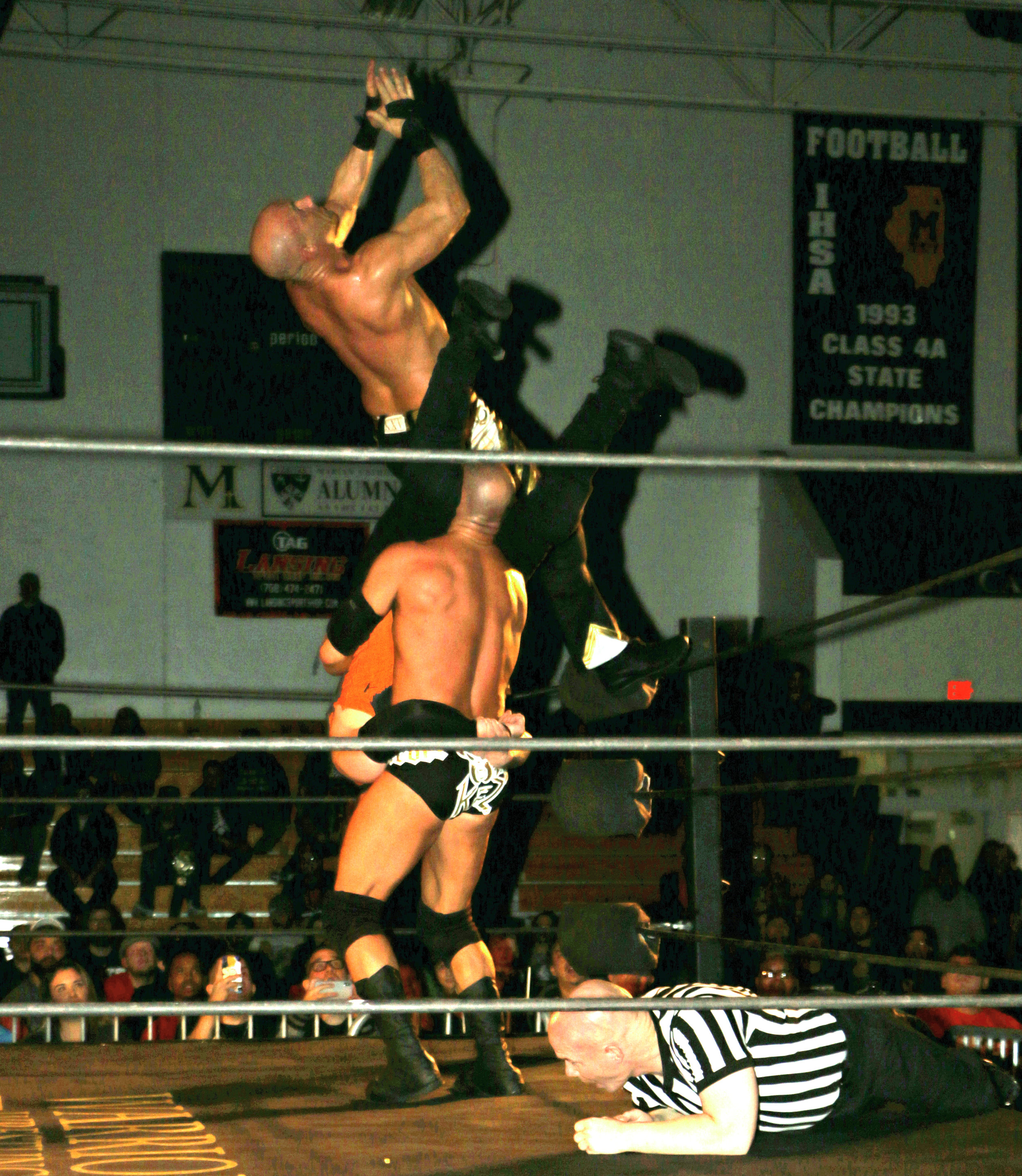 "SCU's Christopher Daniels, top, and Frankie Kazarian perform the ""Best Meltzer Ever"" to oVe's Jake Crist to win the main event six-man tag team match at Warrior Wrestling 4 on Friday, March 15. (Photo by Mike Pankow)"