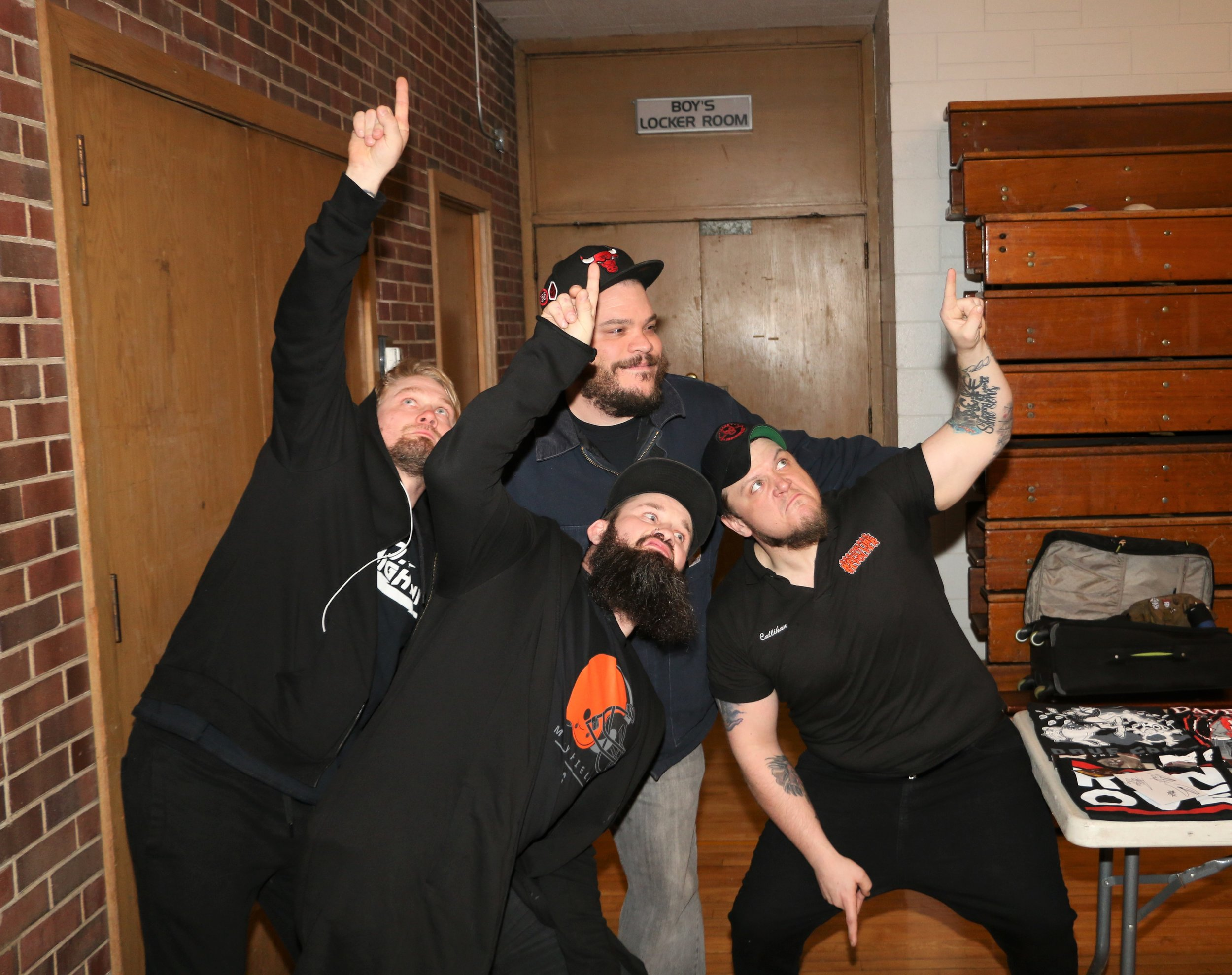 Members of oVe, Jake Crist, from left, Dave Crist and Sami Callihan, pose with a fan while doing a tribute to ECW legend Sabu during Warrior Wrestling 4 Fan Fest.  (Photo by Mike Pankow)