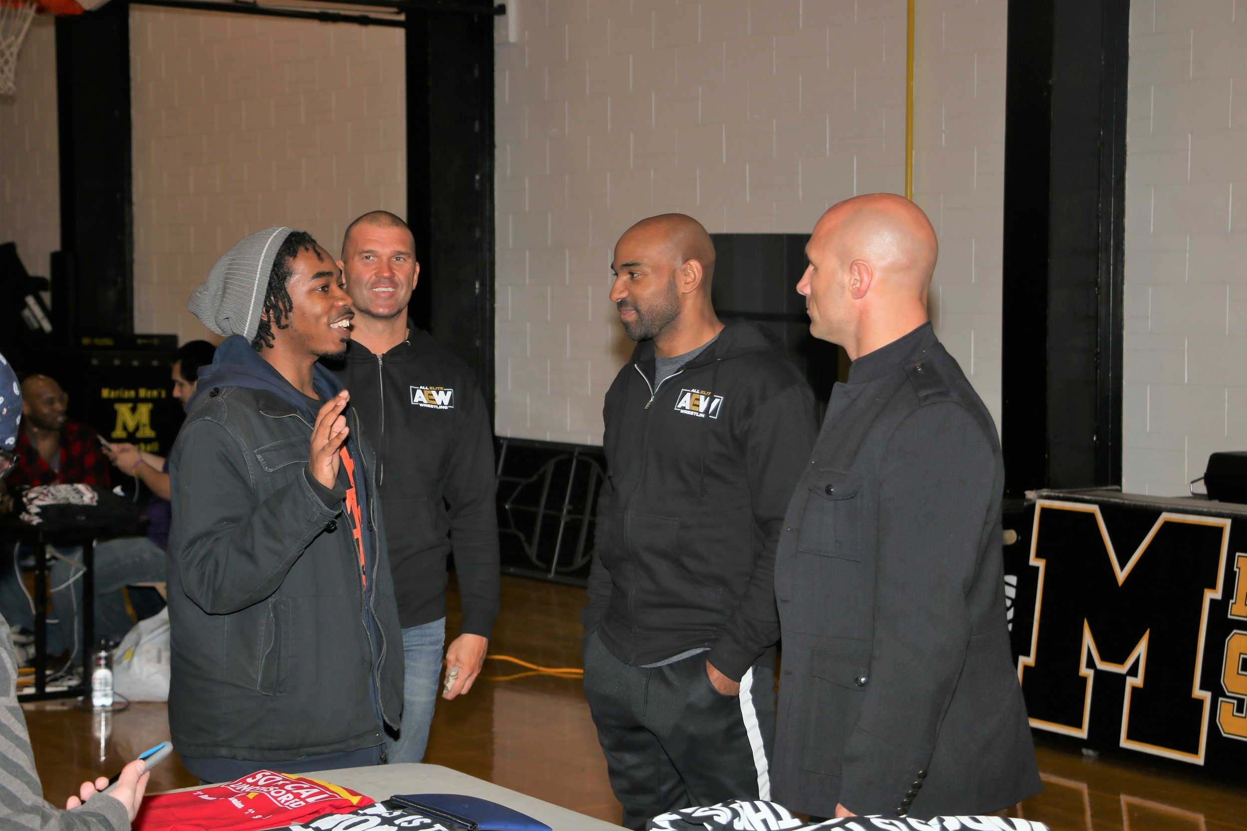 A fan talks with So Cal Uncensored's Frankie Kazarian, Scorpio Sky and Christopher Daniels during the VIP Fan Fest.