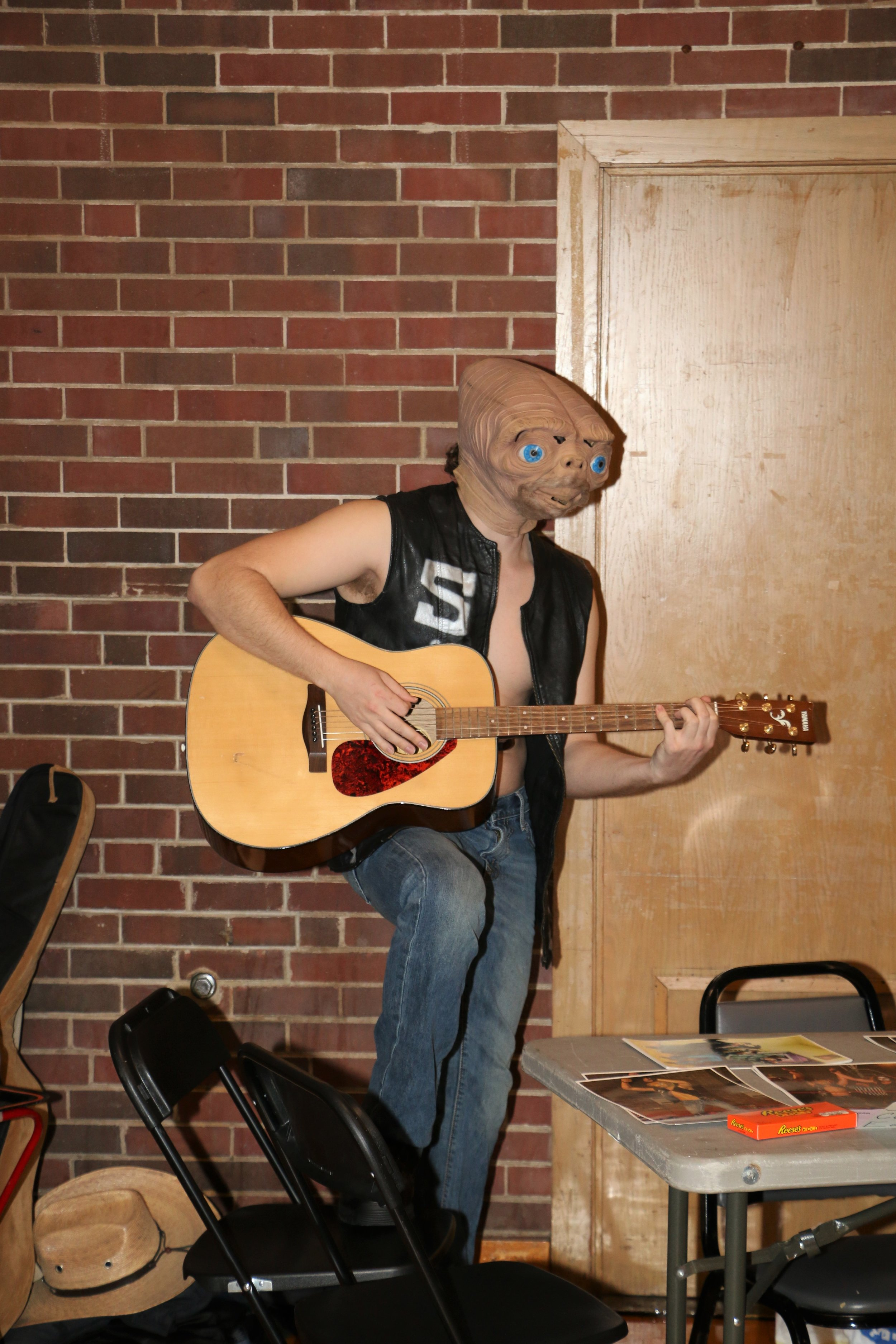 Stone Cold E.T. plays the guitar during the VIP Fan Fest.