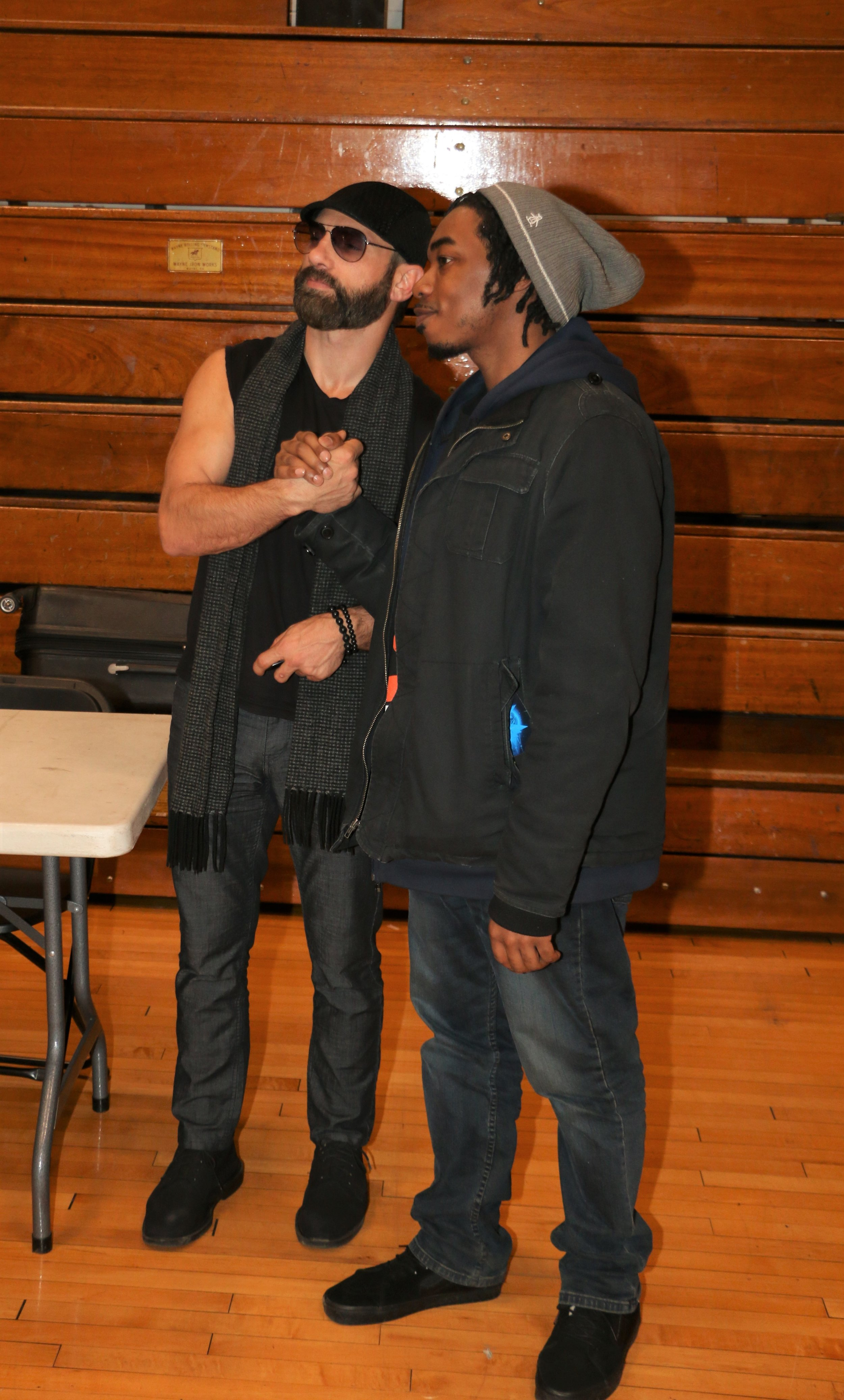 Austin Aries poses with a fan during the VIP Fan Fest.