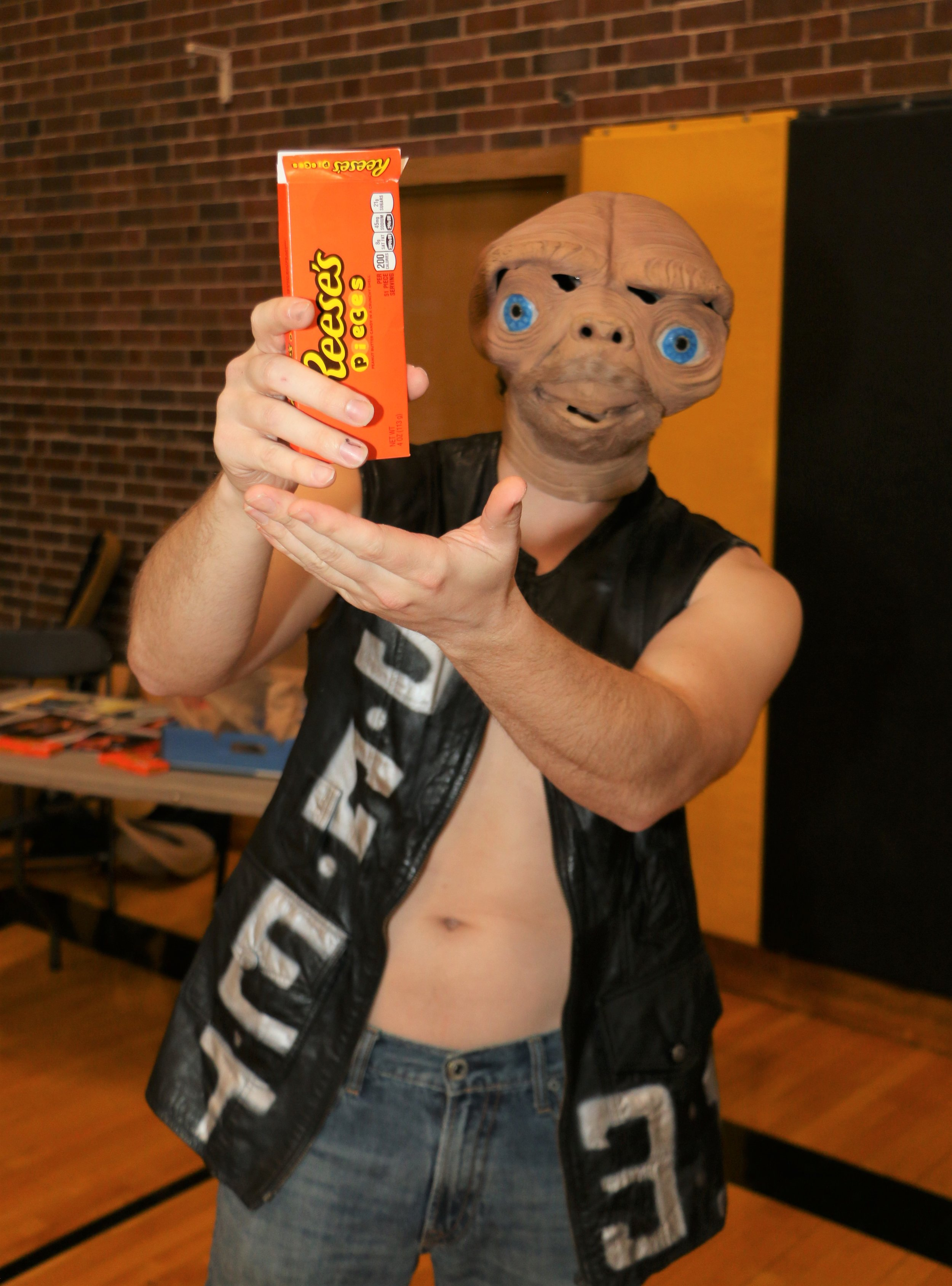 Stone Cold E.T. offers Windy City Slam some Reese's Pieces during the VIP Fan Fest.