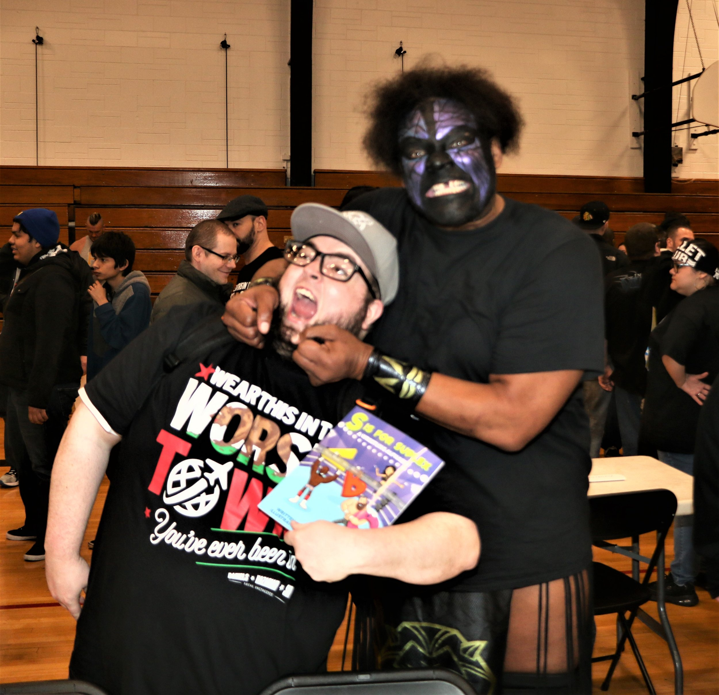 Kongo Kong poses with a fan during the VIP Fan Fest.