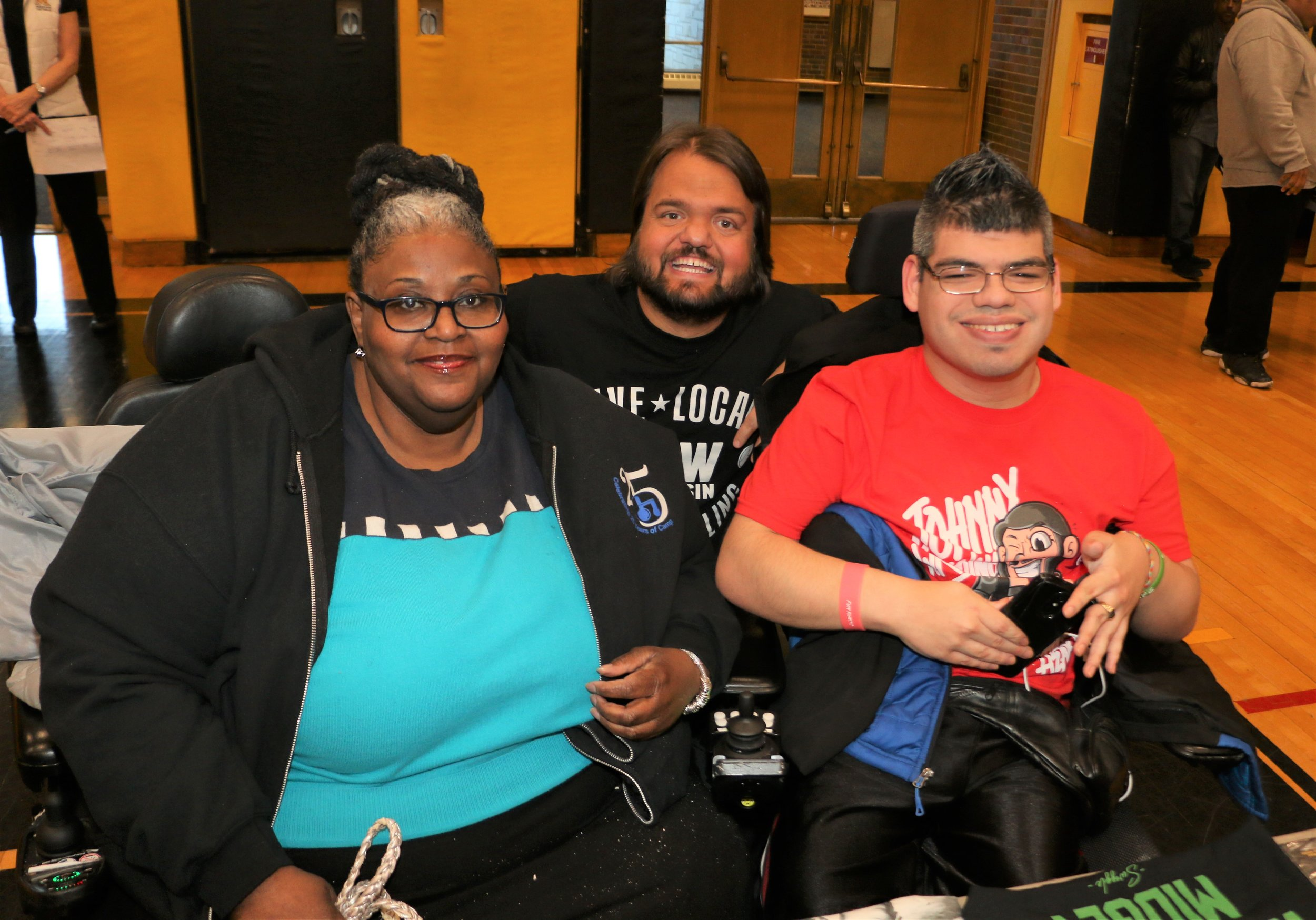 Swoggle (aka Hornswoggle), center, poses with fans during the VIP Fan Fest.