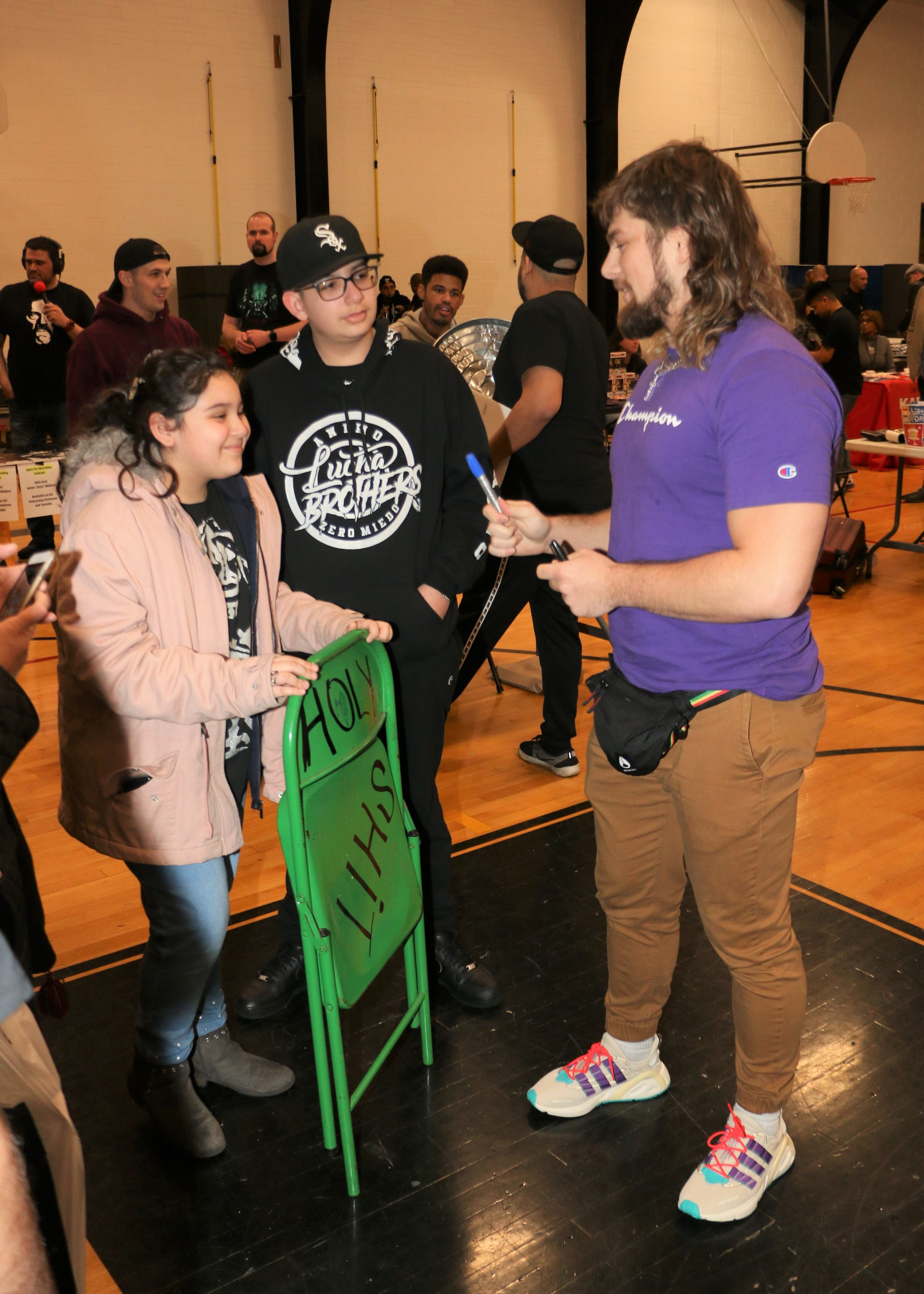 Brian Pillman Jr., right, talks with fans during the VIP Fan Fest.