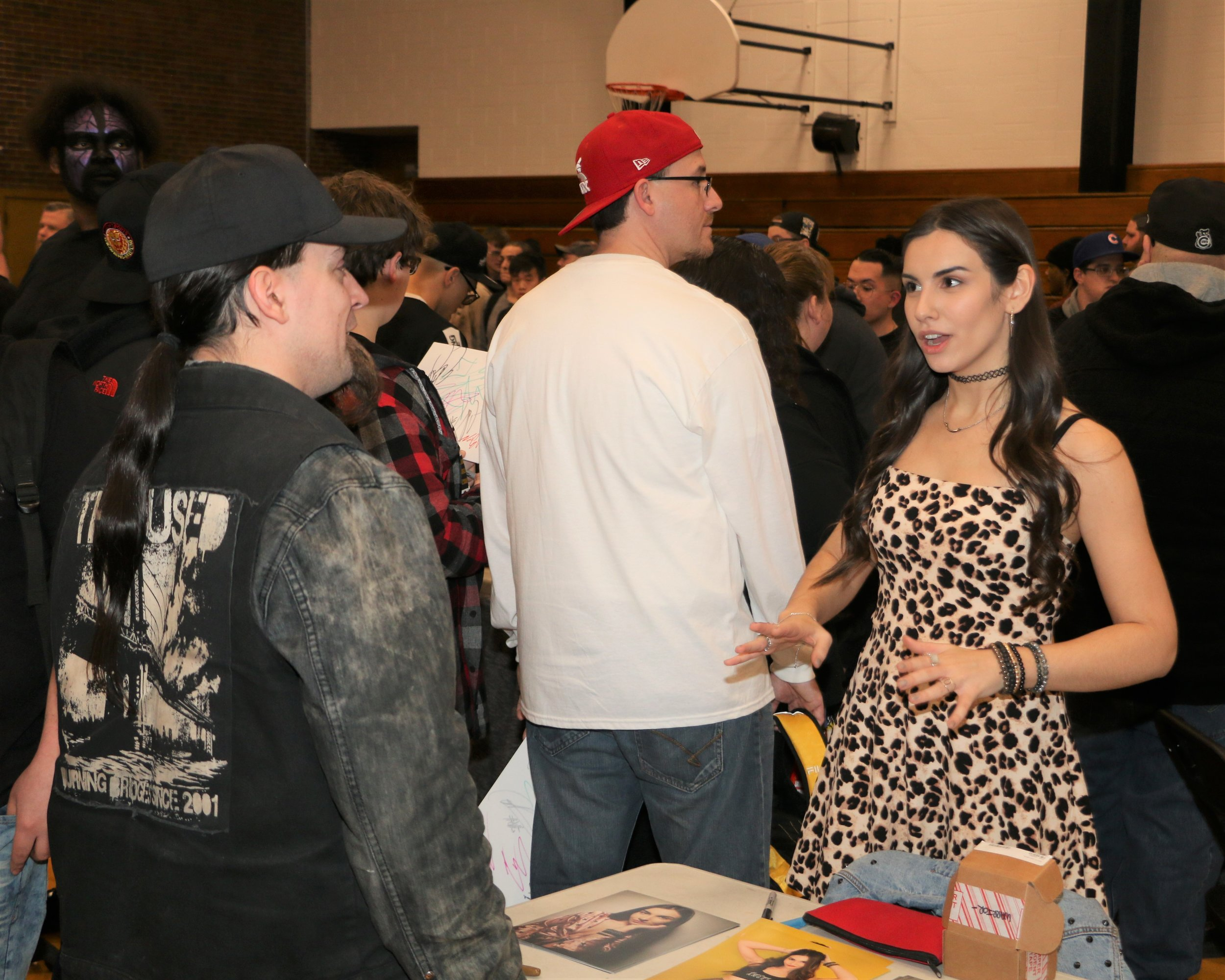 Alicia Atout talks with a fan during the VIP Fan Fest.