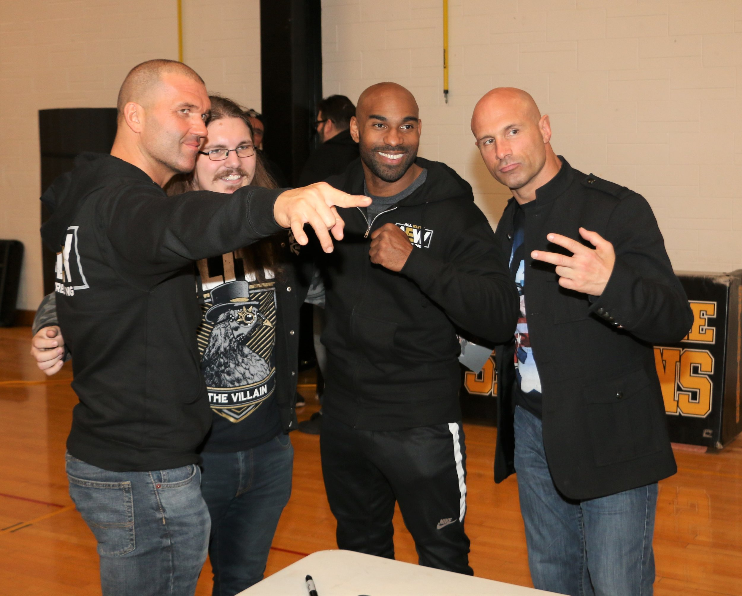 SCU (Frankie Kazarian, from left, Scorpio Sky and Christopher Daniels) pose with a fan during the VIP Fan Fest.