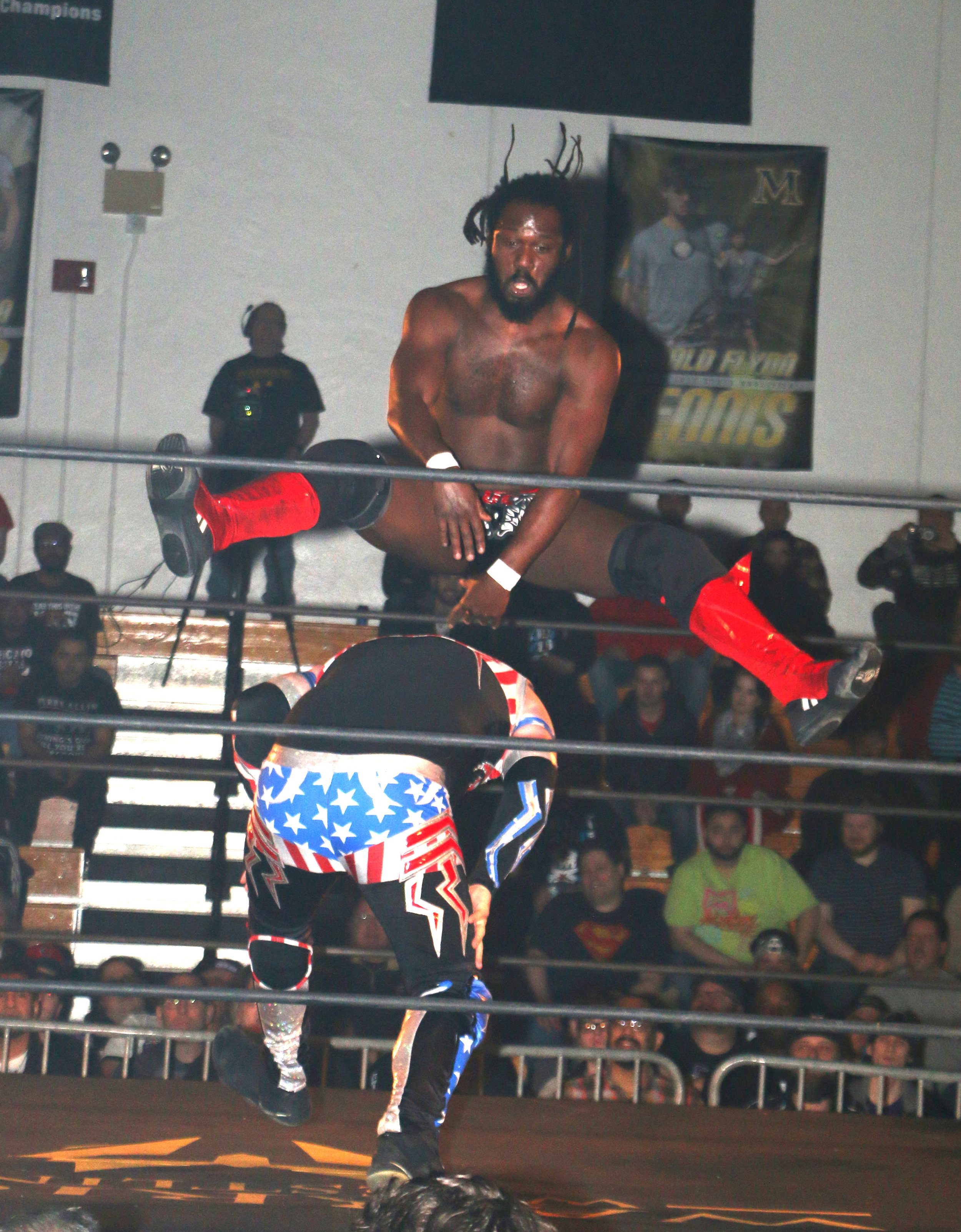 Rich Swann leapfrogs Gringo Loco during the six-man scramble match.