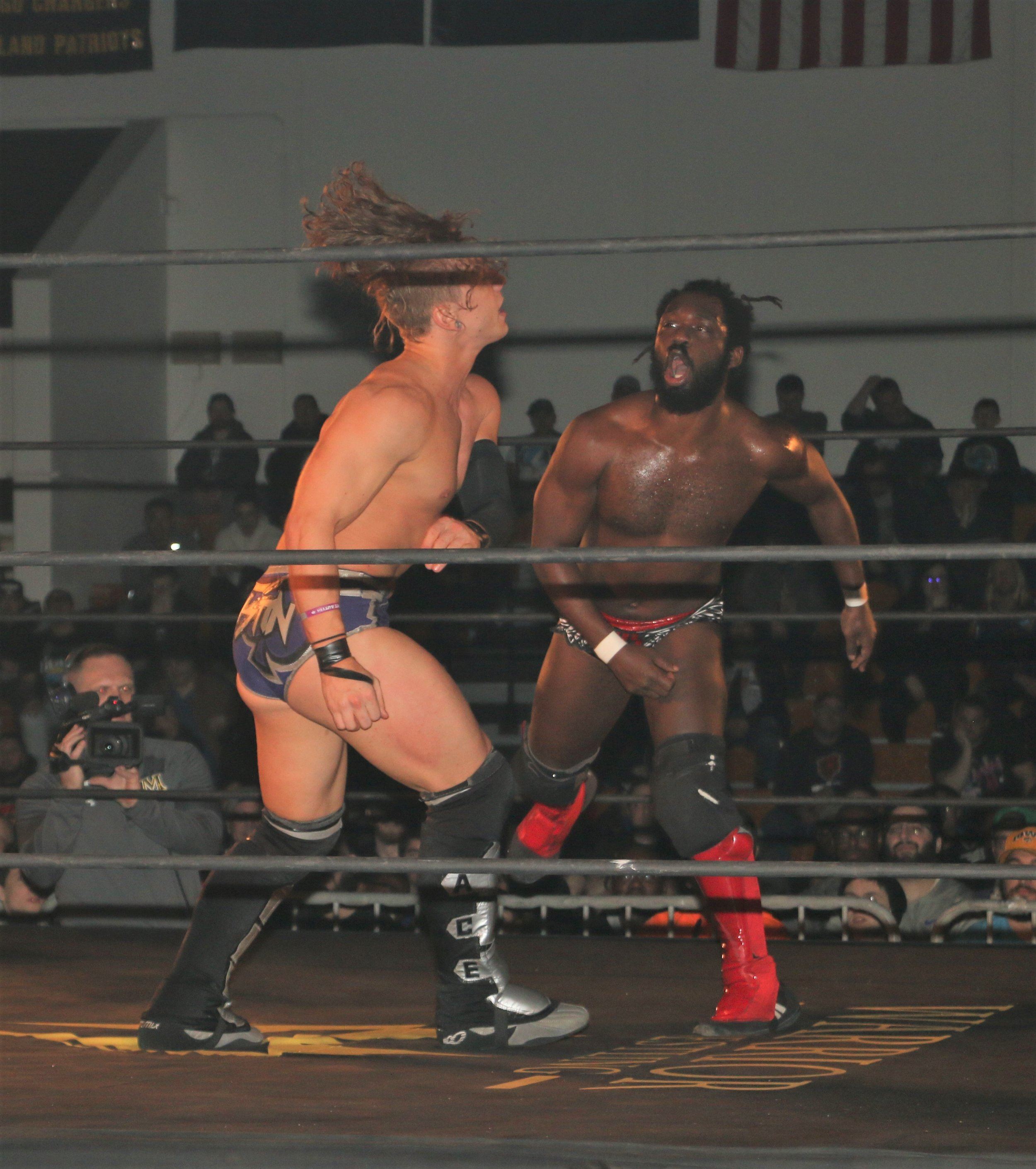 Ace Austin, left, goes toe-to-toe with Rich Swann the six-man scramble match.