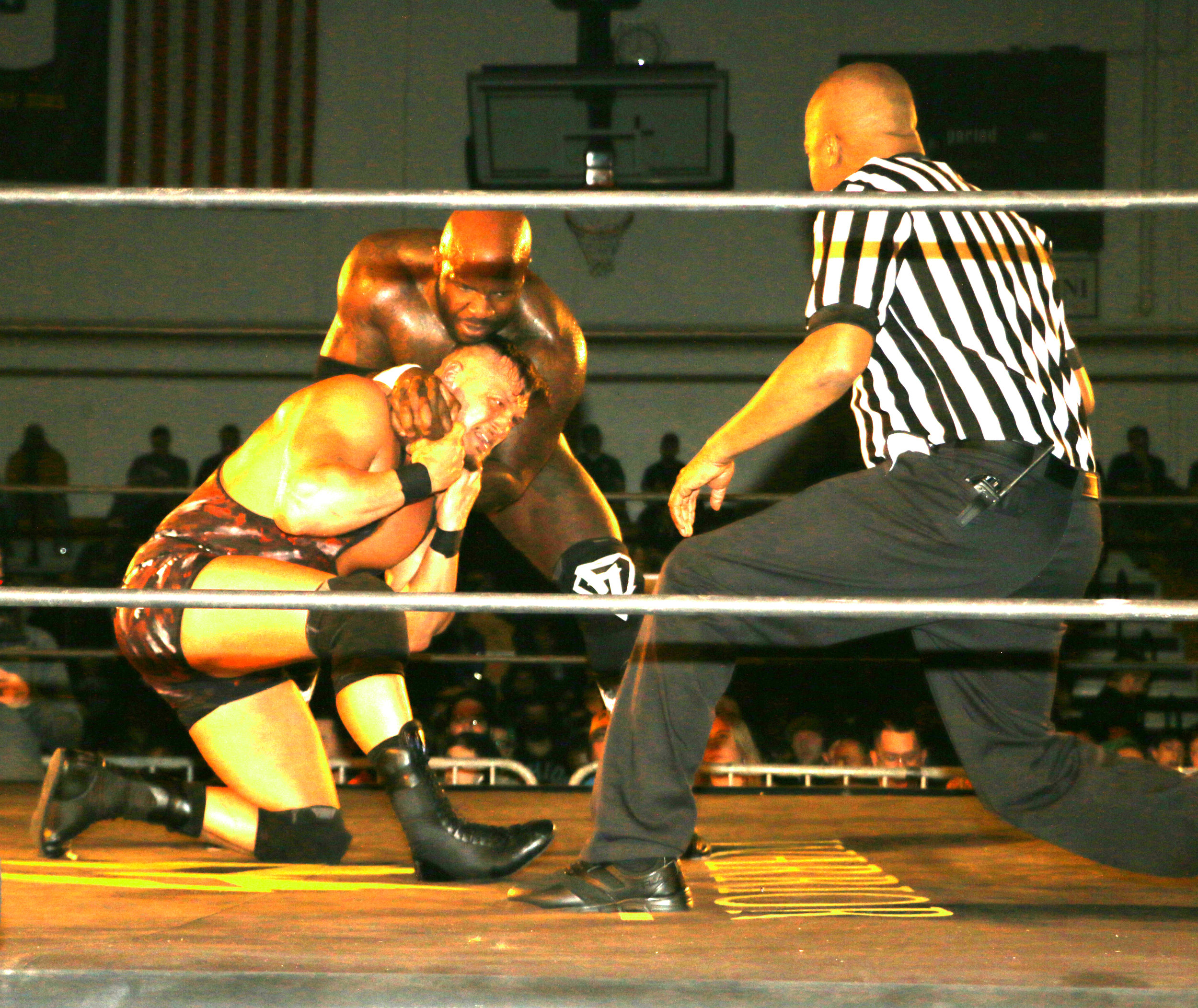 Referee Robert King checks on Wardlow as Moose continues with the headlock.