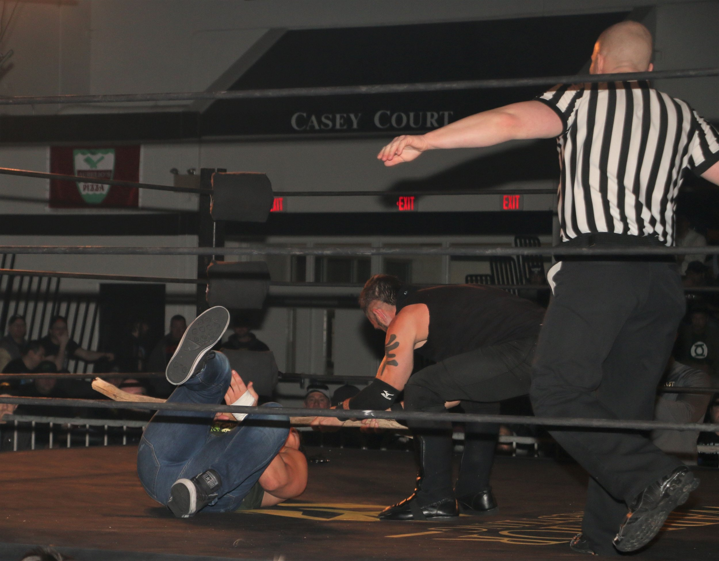 Austin Aries delivers a stick shot to Eddie Edwards, getting disqualified in the process.