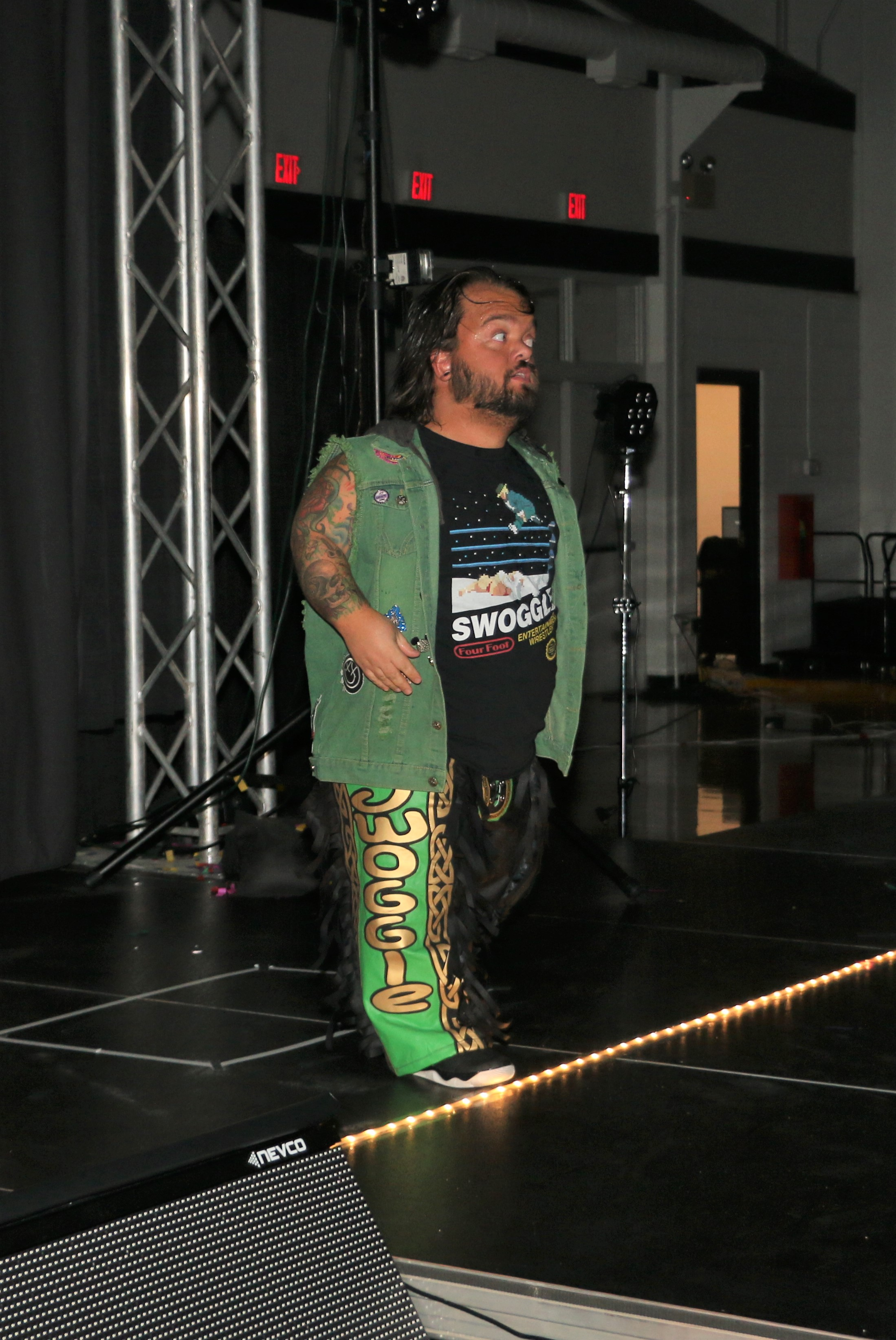 Hornswoggle enters the arena before the three-way tag team match.