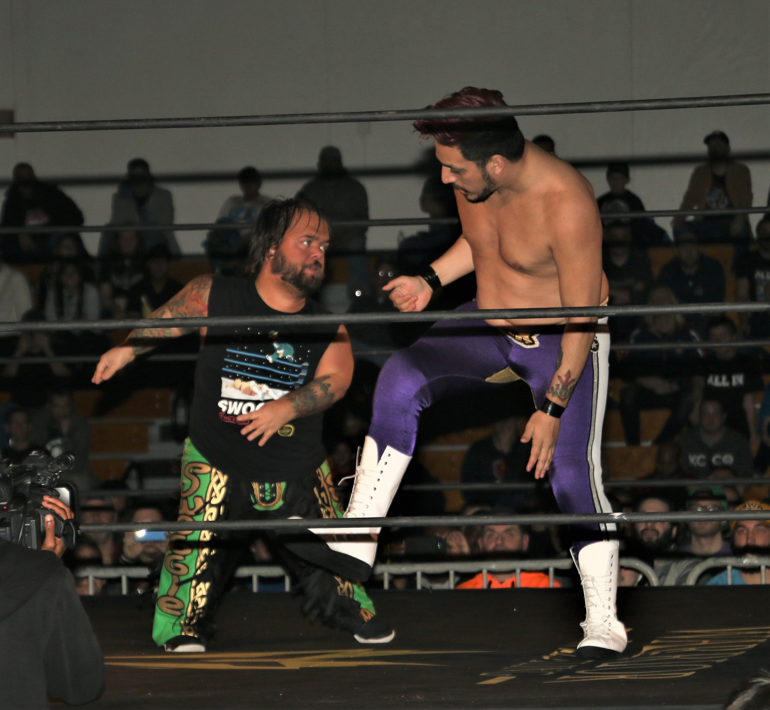 Matt Knicks, right, goes to toe-to-toe with Hornswoggle.