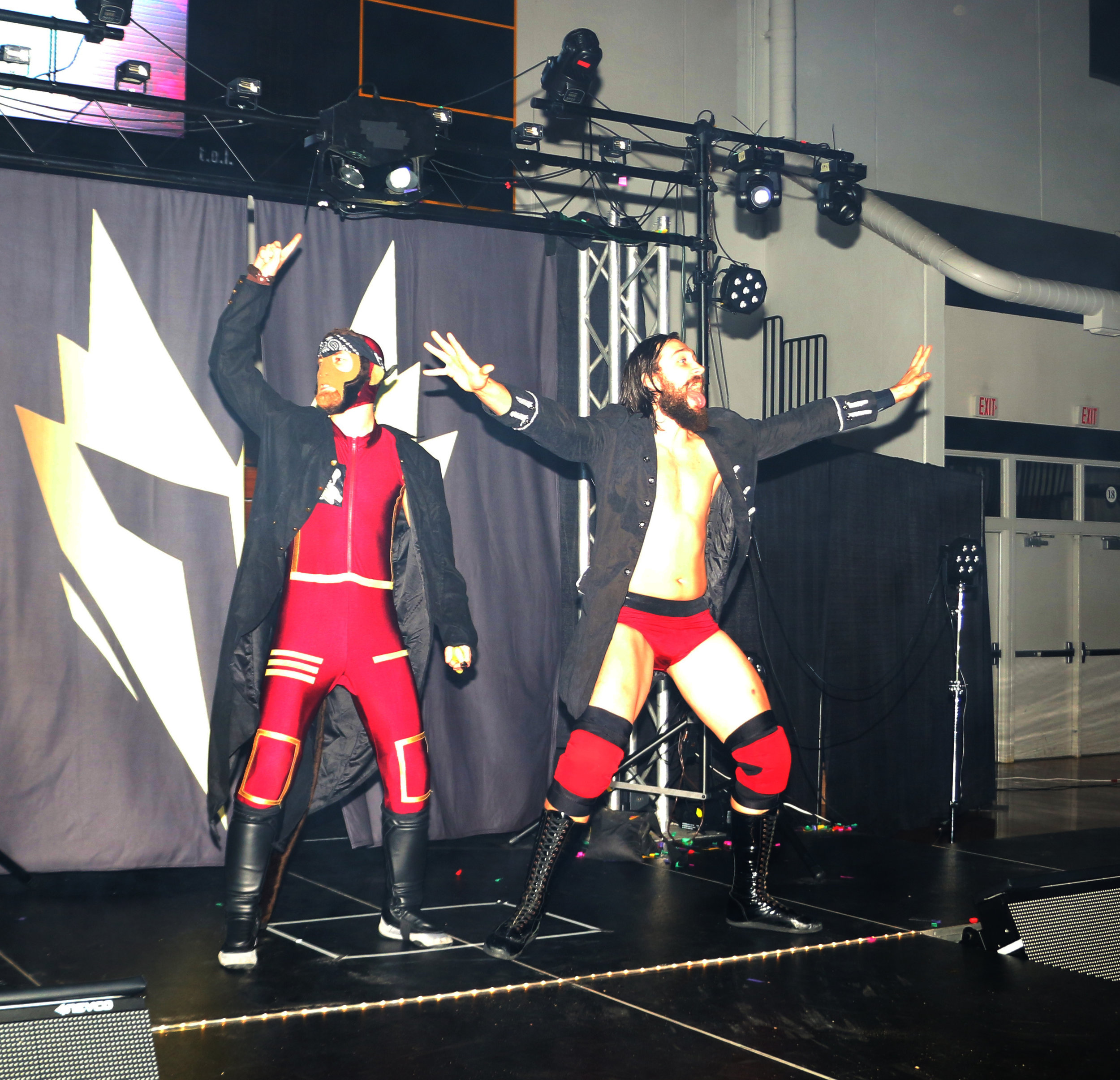 The Space Pirates, Space Monkey, left, and Shane Sabre, enter the arena for the three-way tag team match.