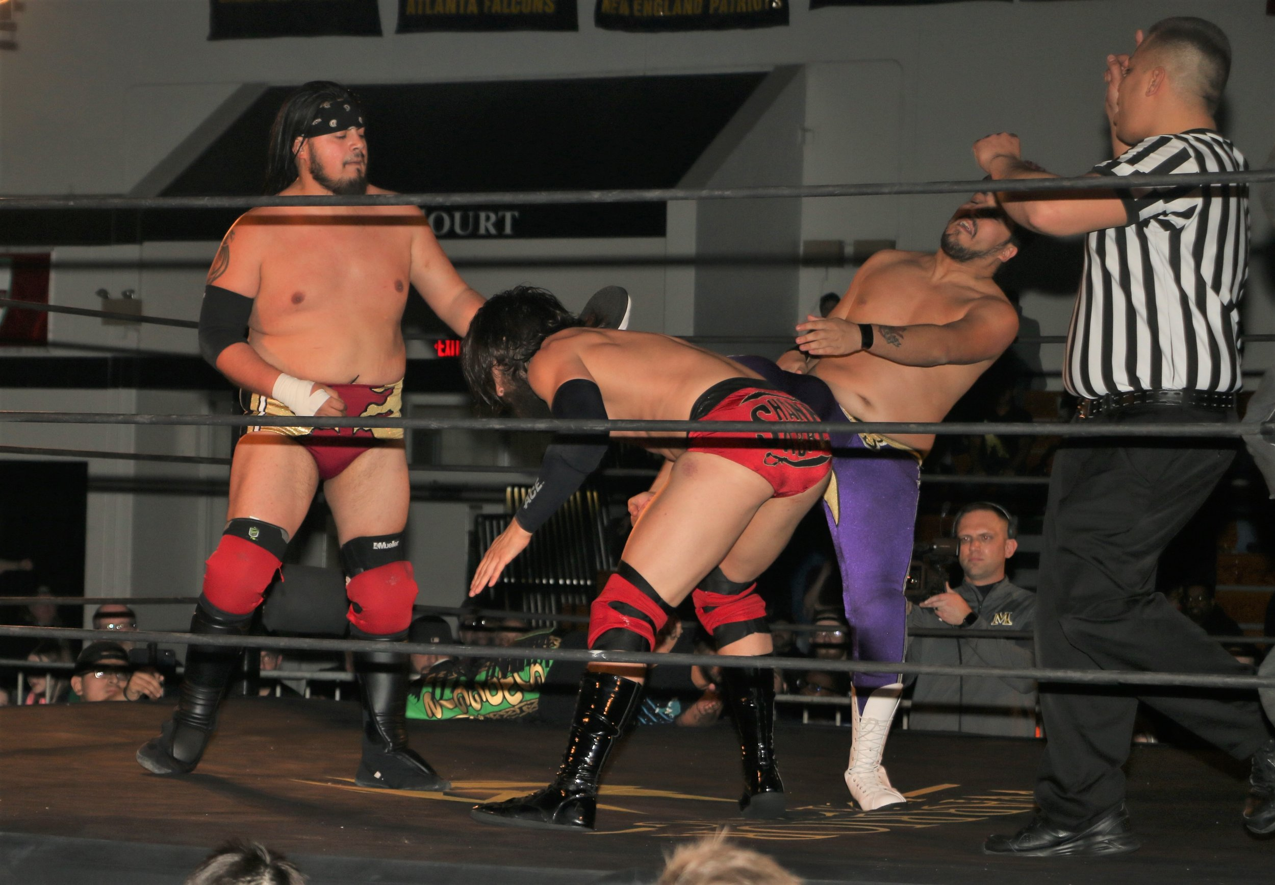 Chris Castro, left, and Matt Knicks, right, double team Shane Sabre during the three-way tag team match.