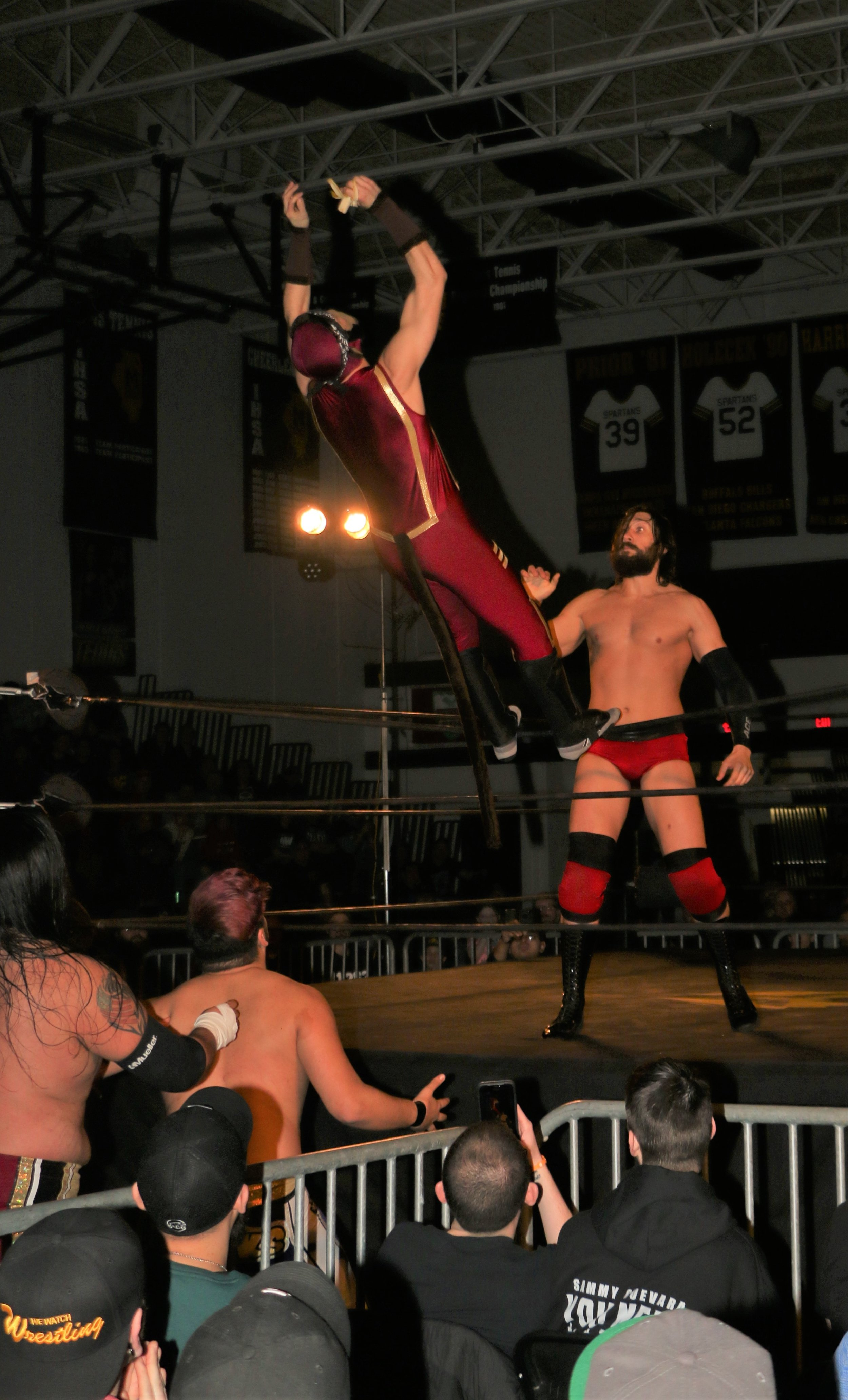 Space Monkey dives out of the ring onto his opponents during the three-way tag team match.