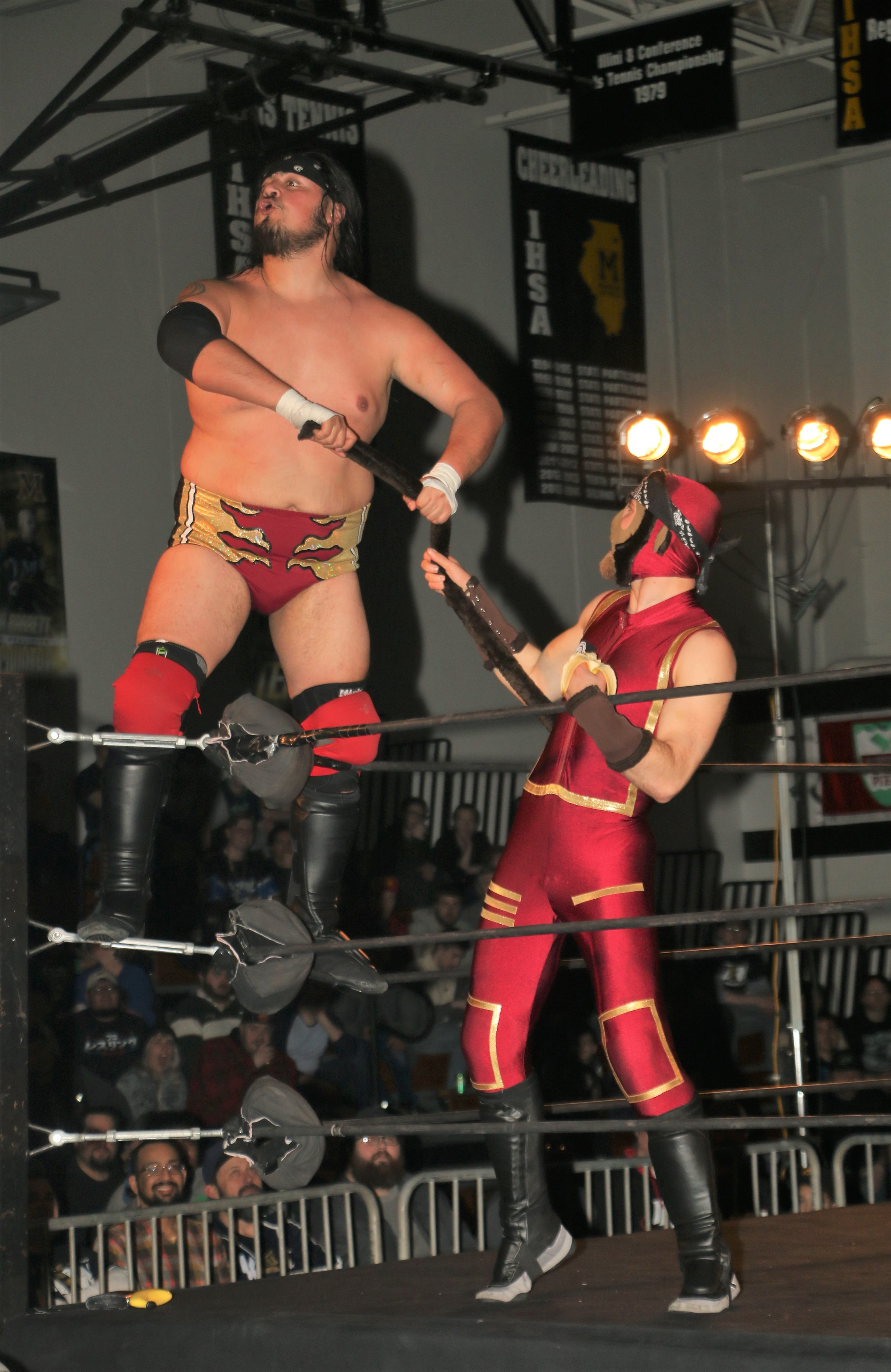 Chris Castro pulls on Space Monkey's tail during the three-way tag team match.