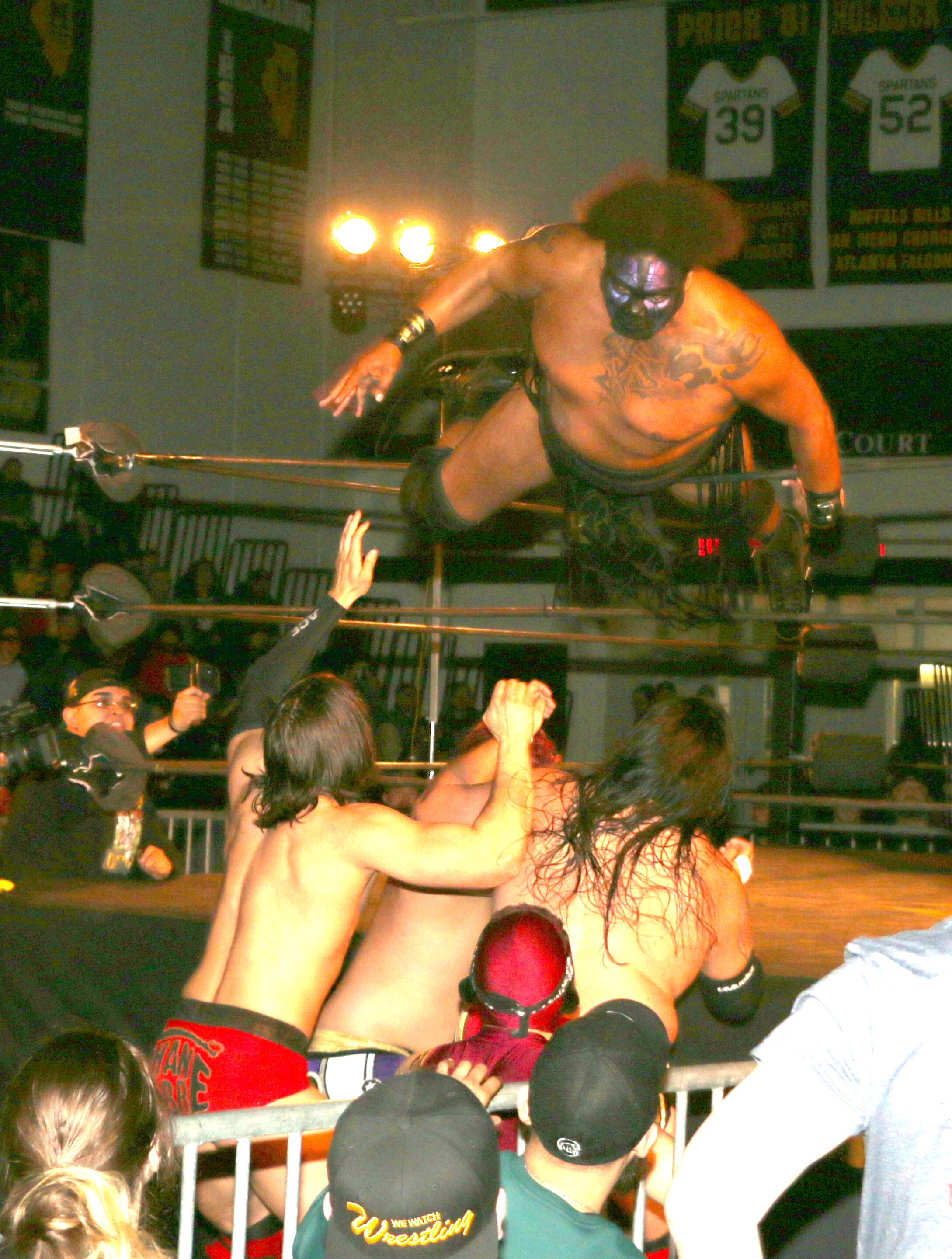 Air Kong: Kongo Kong dives through the ropes onto his opponents during the three-way tag team match.