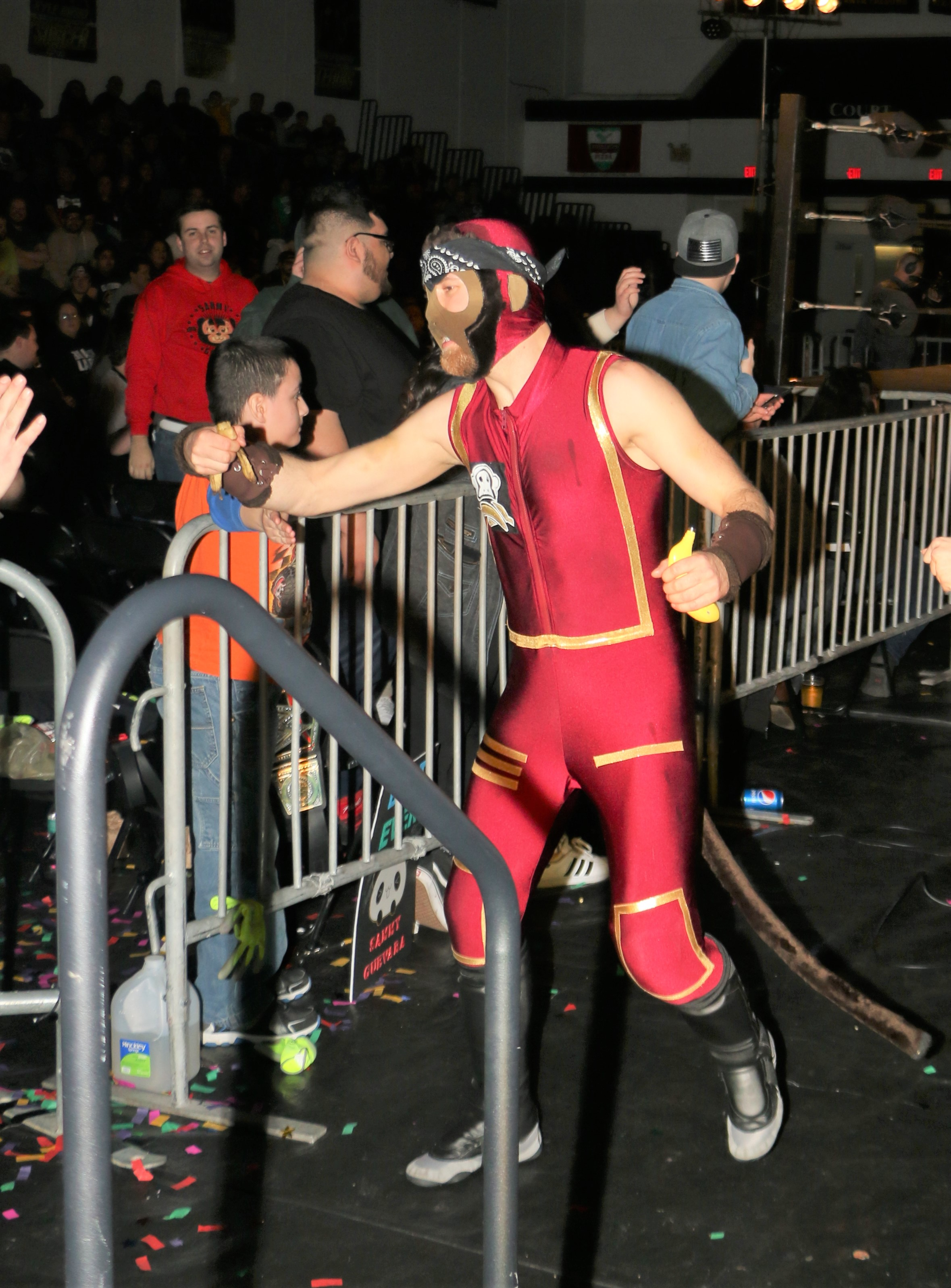 Space Monkey celebrates with fans after the Space Pirates won the three-way tag team match over Kongo Kong & Hornswoggle and Matt Knicks & Chris Castro.