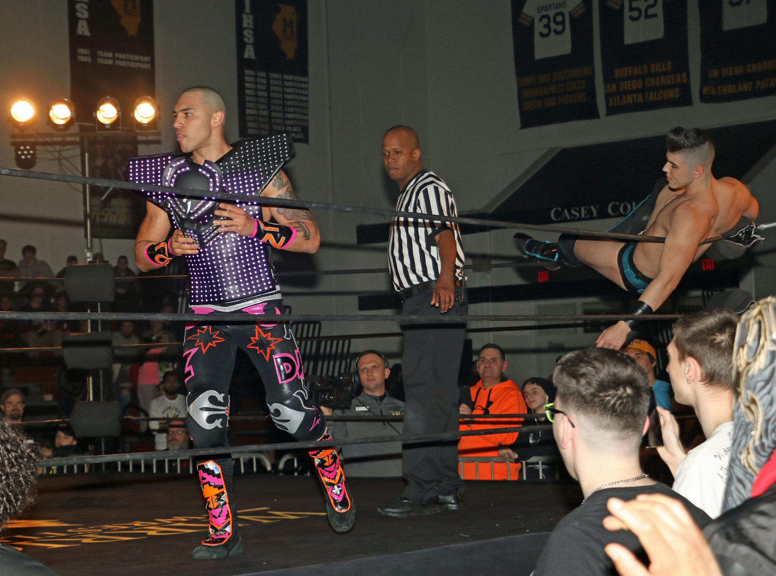 DJZ, left, prepares for the match while Sammy Guevara rests on the ropes.