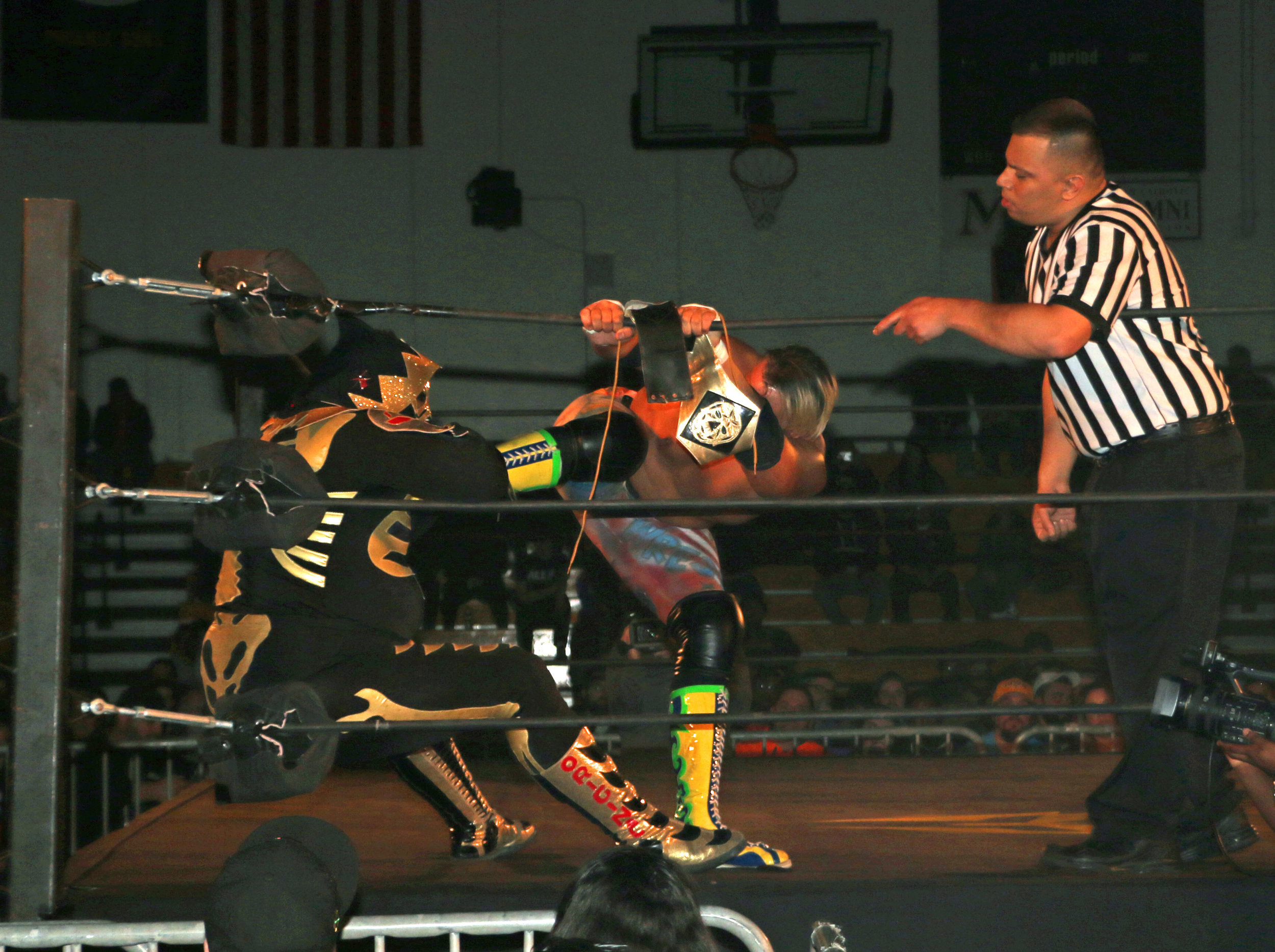 Referee Jeremy Tillema, right, yells at Sam Adonis for choking LA Park in the corner.