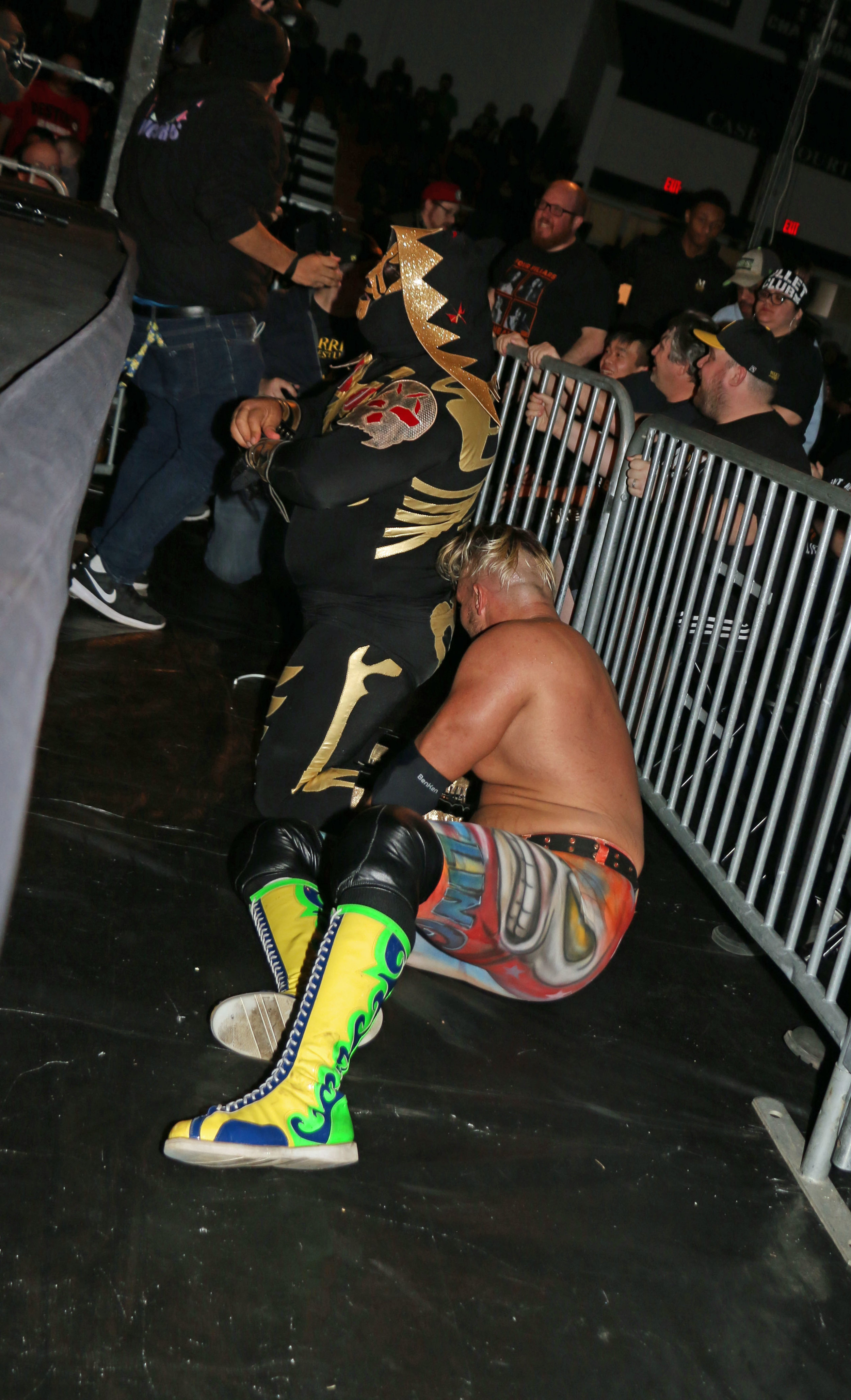 LA Park gets up after diving onto Sam Adonis on the outside of the ring.