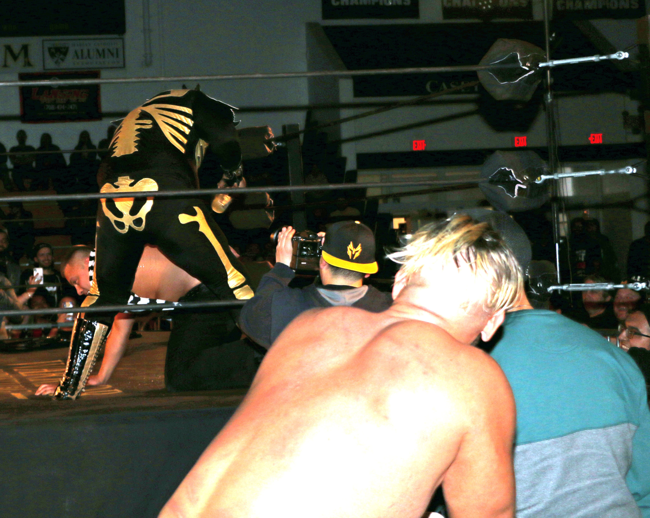 LA Park pours beer down referee Jeremy Tillema's pants as Sam Adonis watches from the outside.
