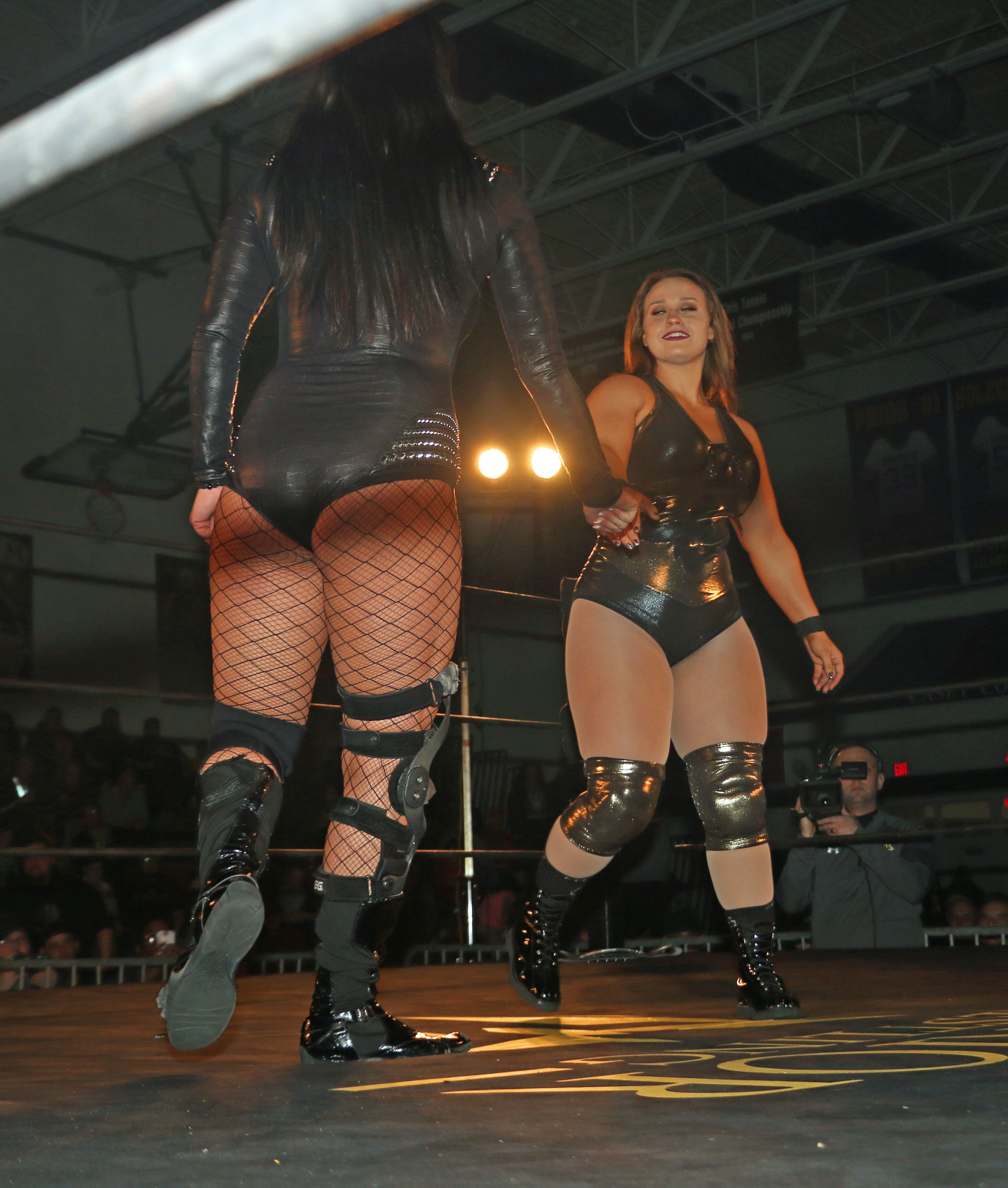 Jordynne Grace, right, shakes the hand of Lisa Marie Varon before the match.